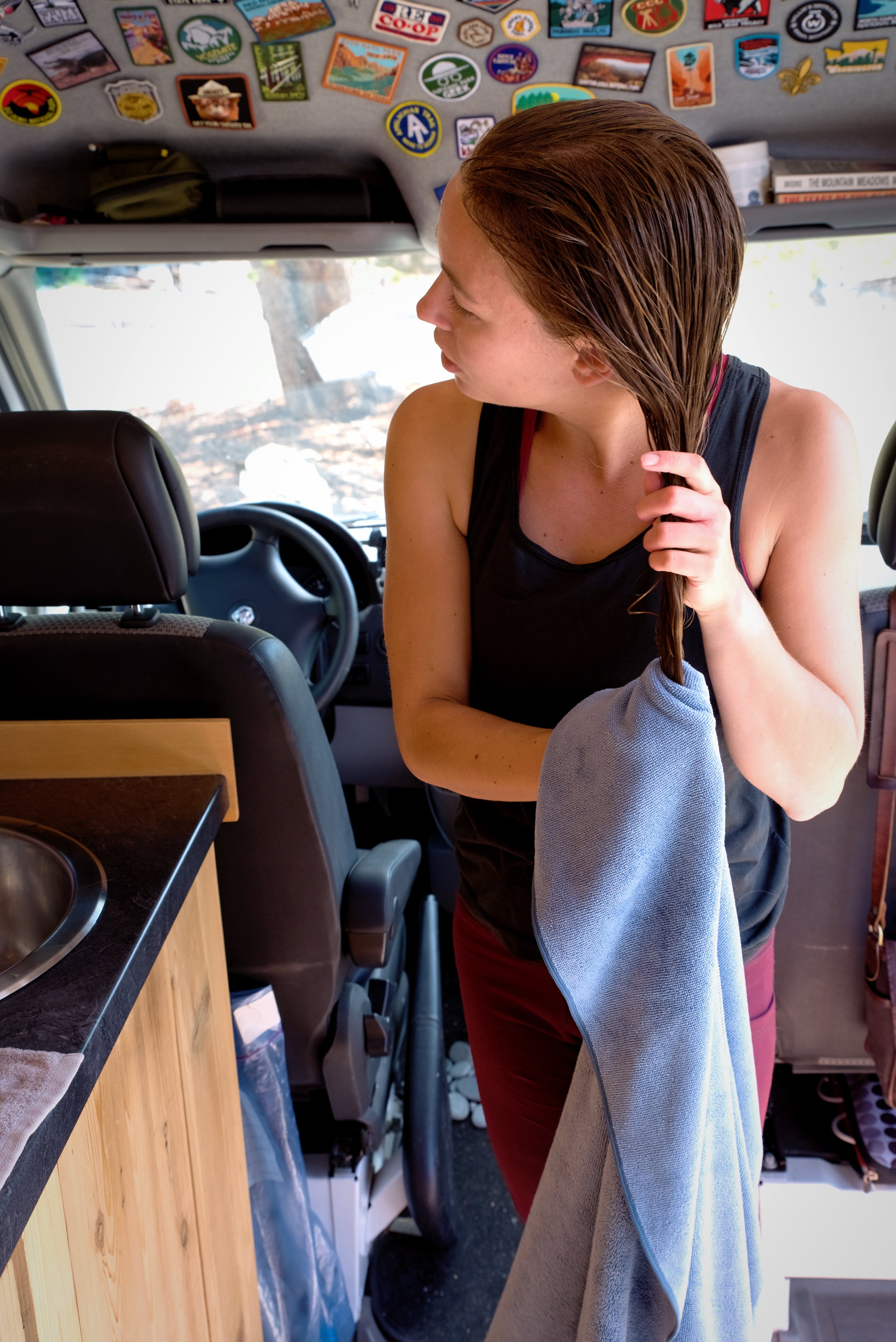 Even if you haven't been able to shower in a while, washing your hair while living in a van can make you feel really refreshed.
