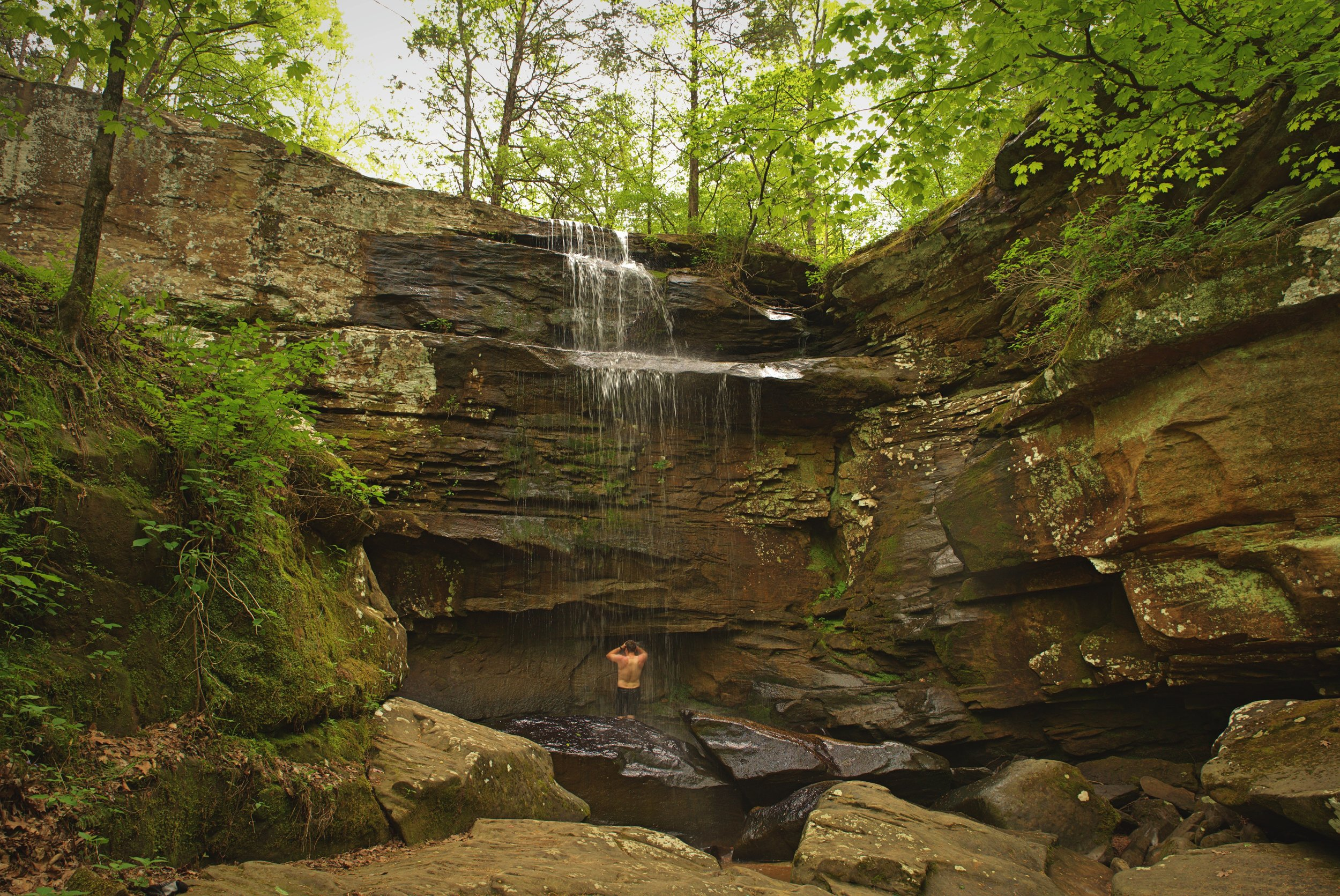 Ian enjoys a waterfall on a hot day in the Shawnee National Forest in Illinois. We don't use sap when rinsing off in natural water sources.