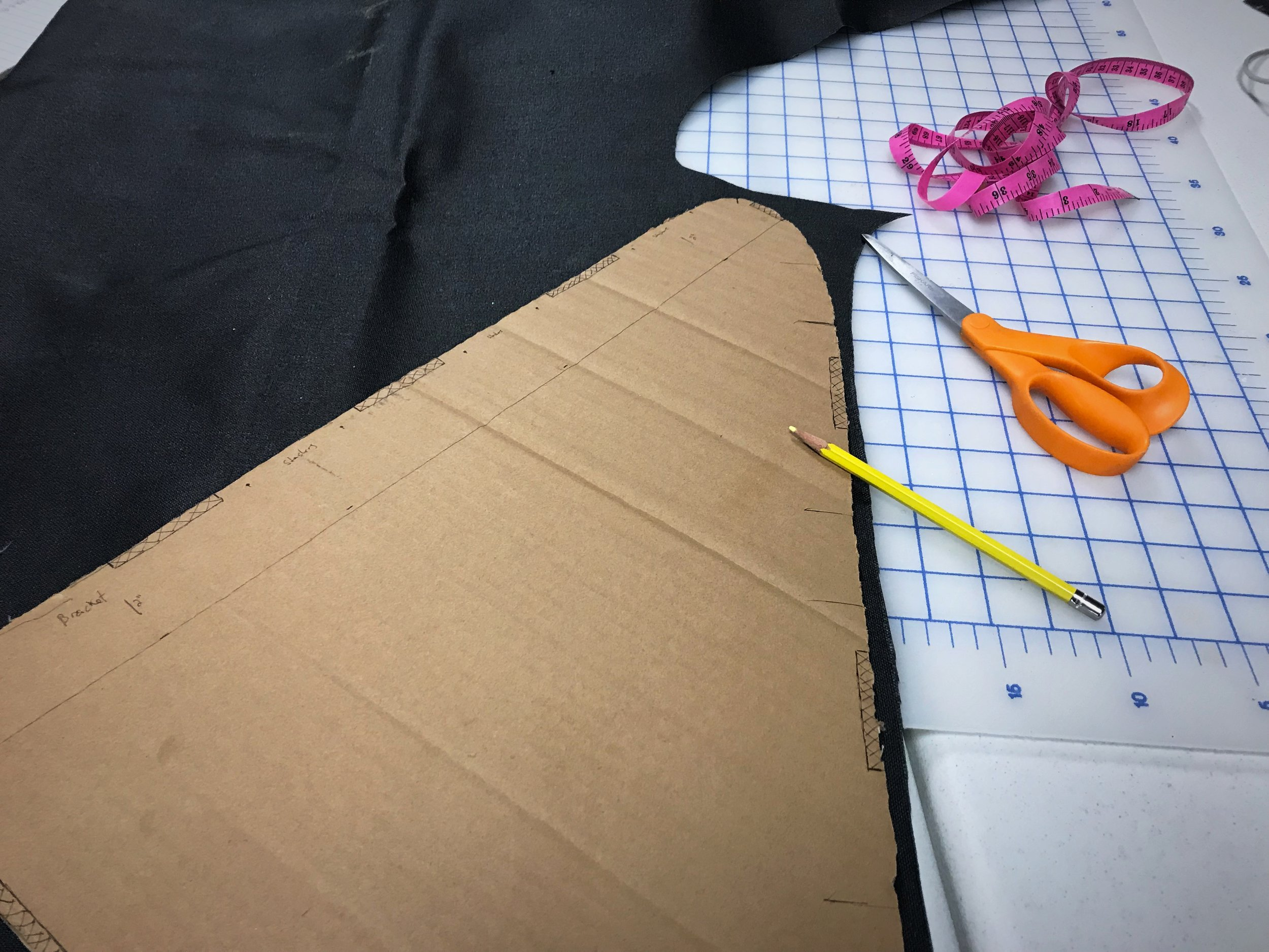 Trace the stencil you created onto your fabric, leaving a half inch buffer around the edge. On one side you will need to factor in extra space so that you have a seam allowance for your zipper.