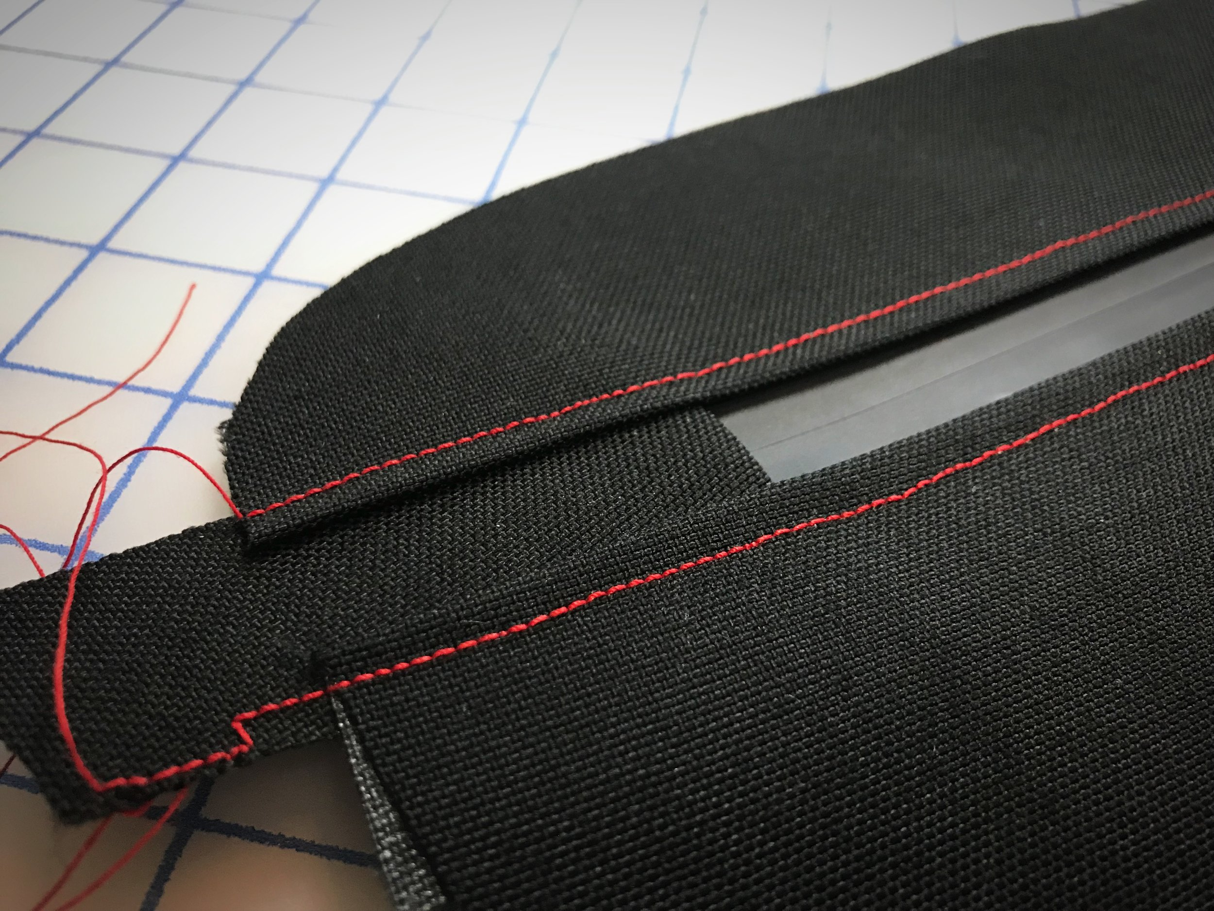 You will want to finish each end of the zipper with a small piece of folded over fabric so that it as long as the panel you are sewing it to.