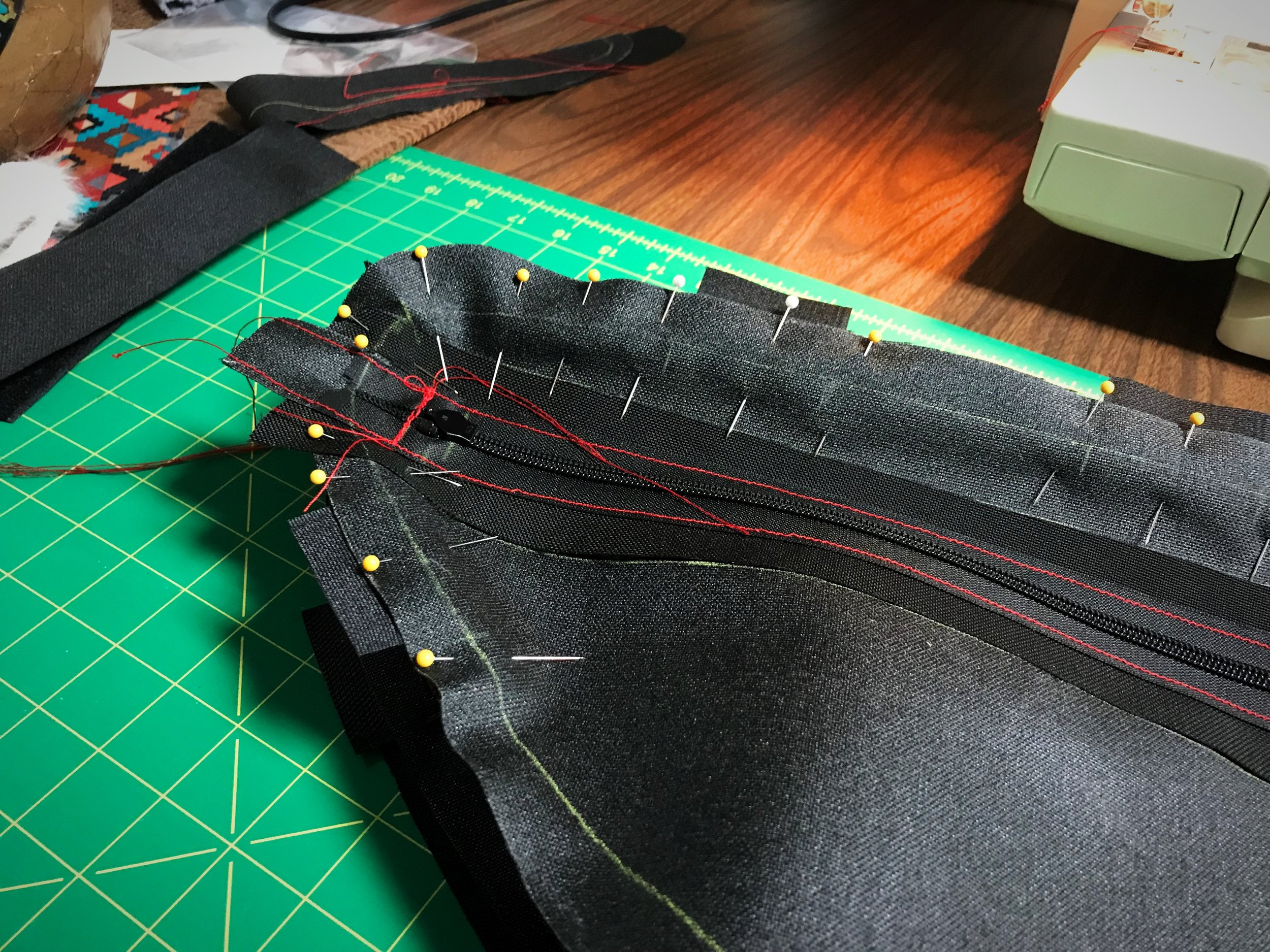 After attaching the edge piece to the first panel, sew the second panel onto the edge pieces. Sewing around the final corner can be a bit tricky, so using a lot of pins will help you hold keep the bag in shape.