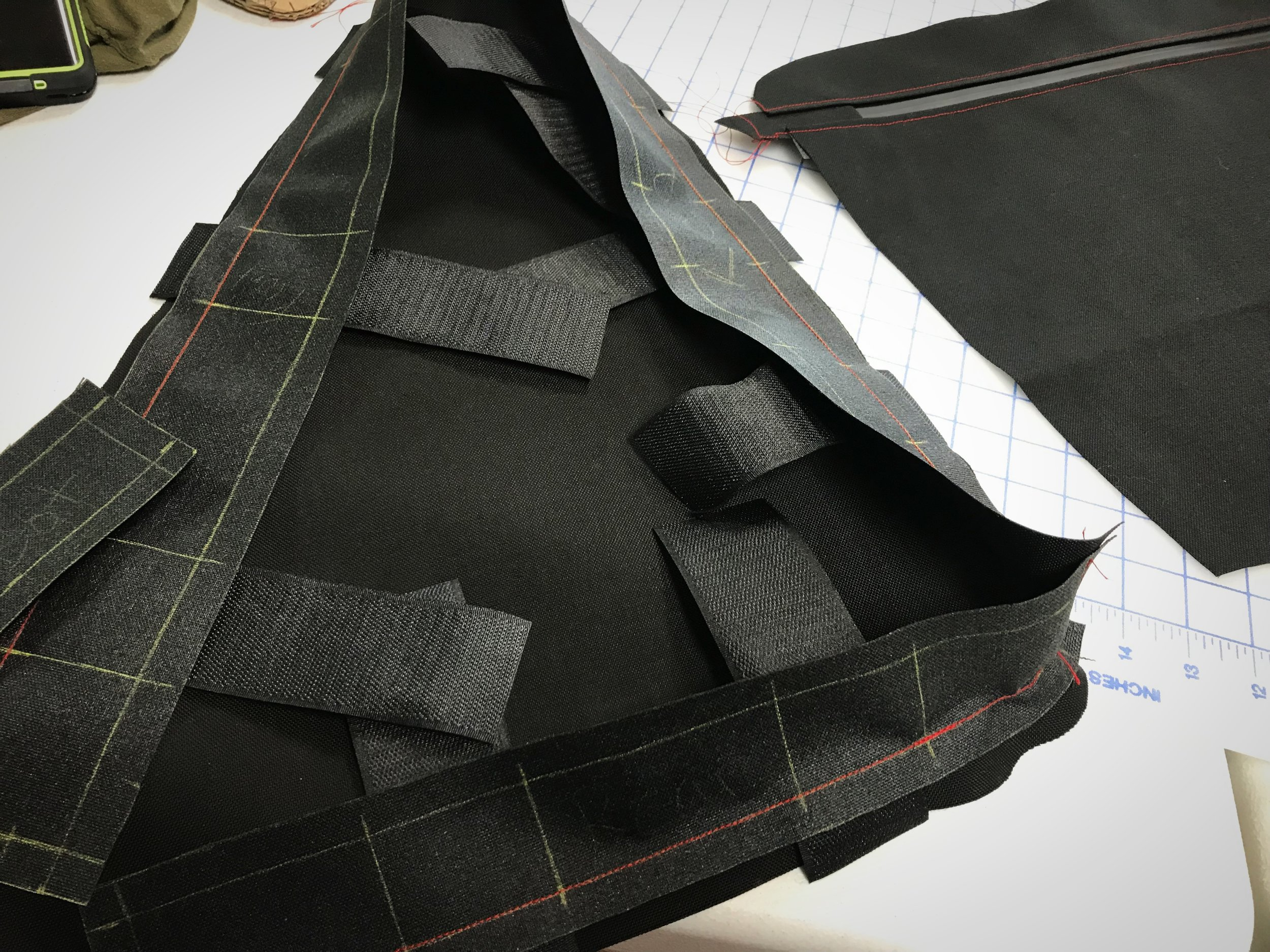 Sew edge piece on all the way around your first side panel, sewing the Velcro into the seam.