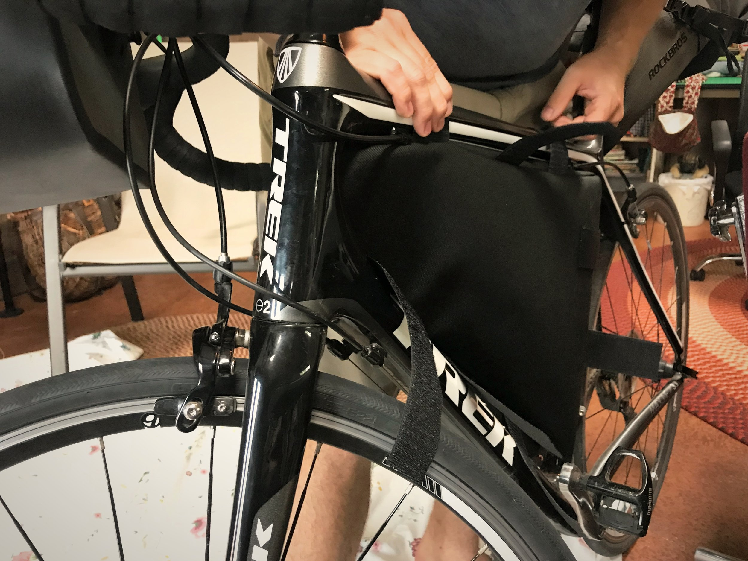 Cut your velcro pieces with a little extra. You can cut them to the exact length later when you fit your bag onto your bike.