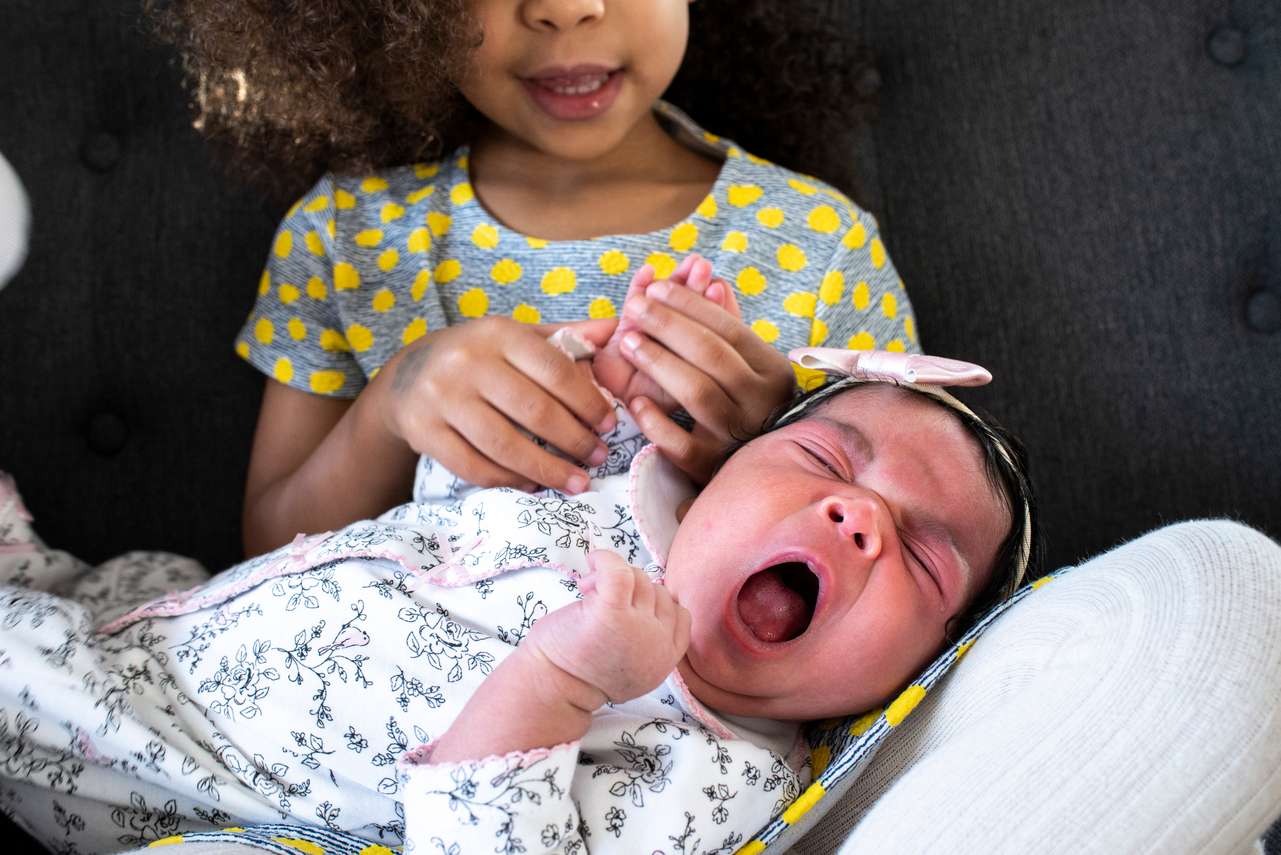 Presenting Little Miss Sunshine. - Just a few days old, this precious little girl was surrounded by curious siblings who couldn't get enough of her. See their story.
