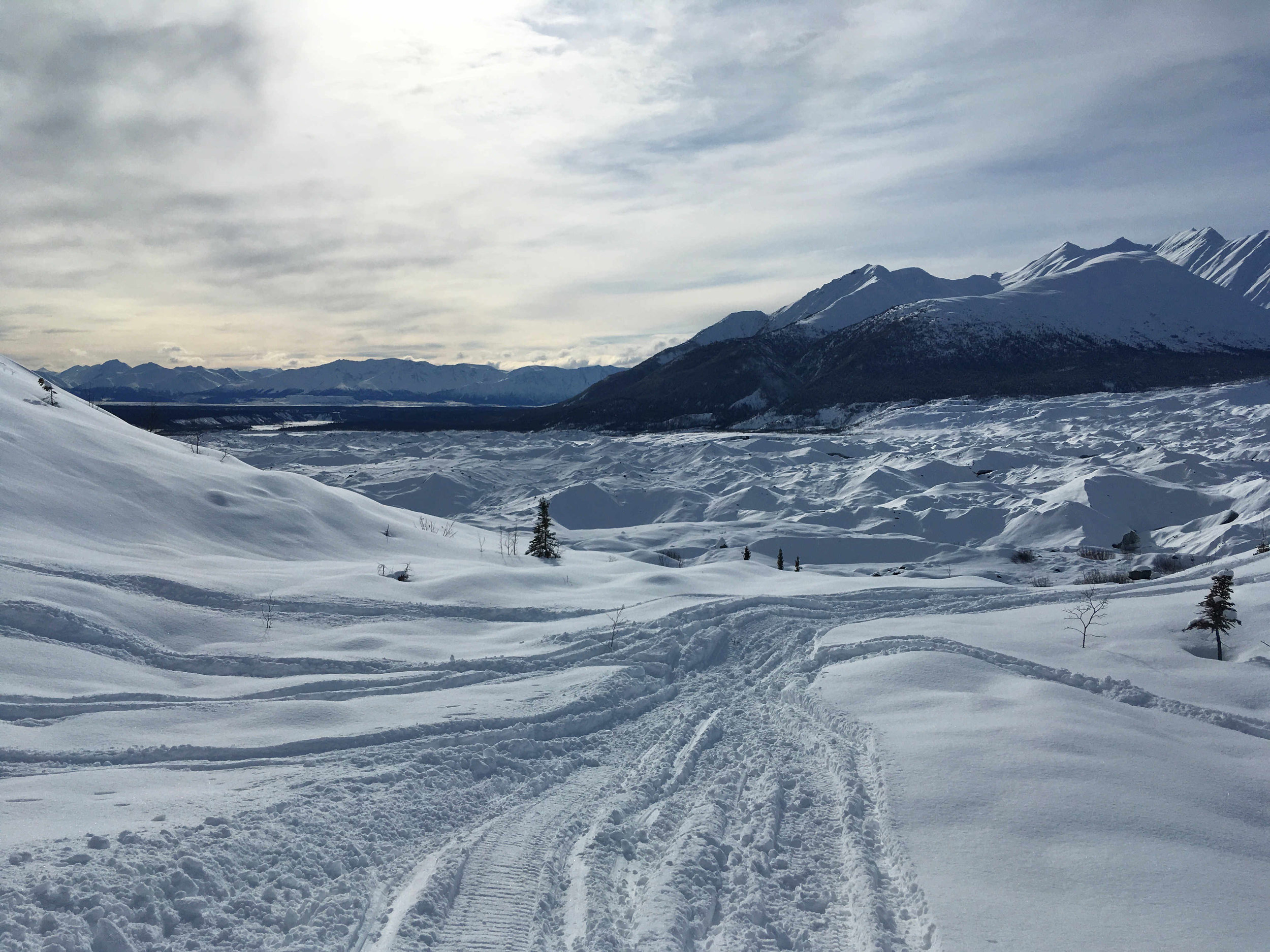 A snow machine track down to the Kennicott Glacier.