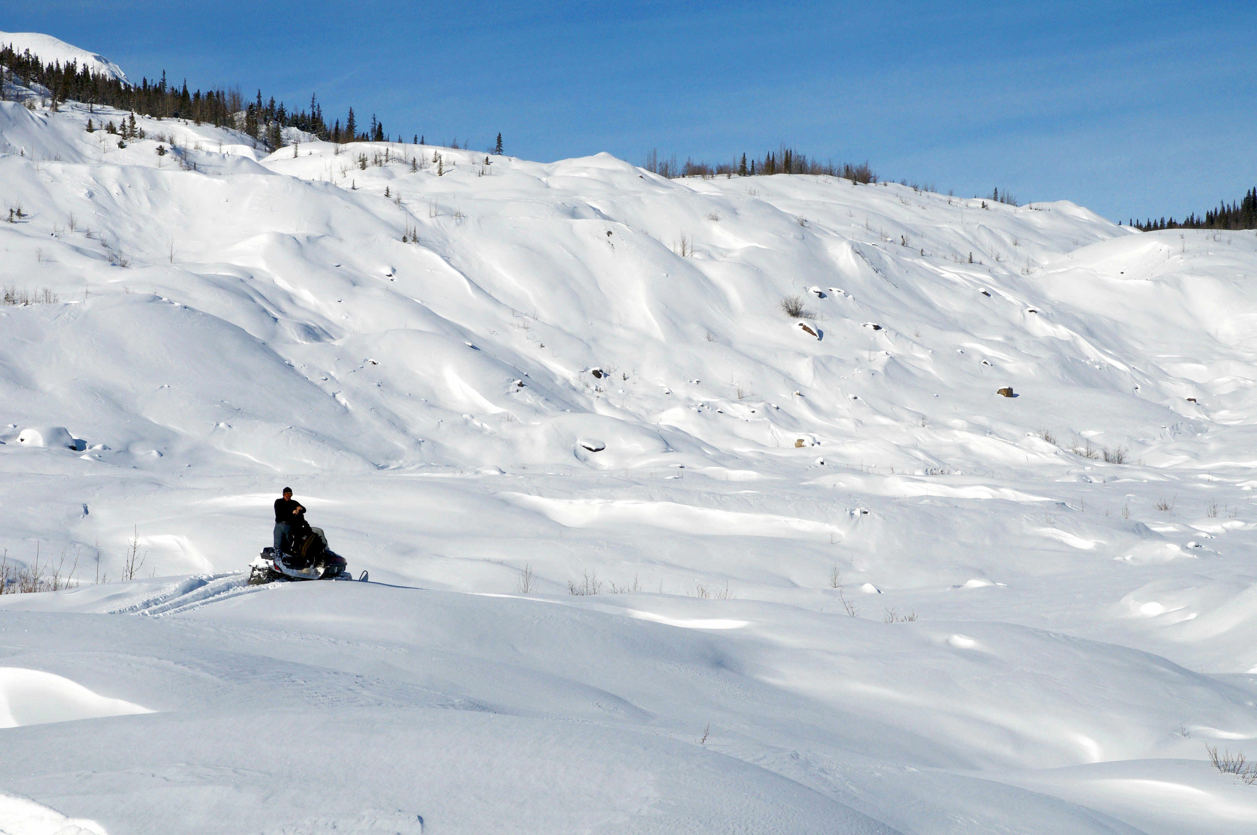 Snow machining on the west side of the Kennicott Glacier.  Photo credit: Ian Gyori