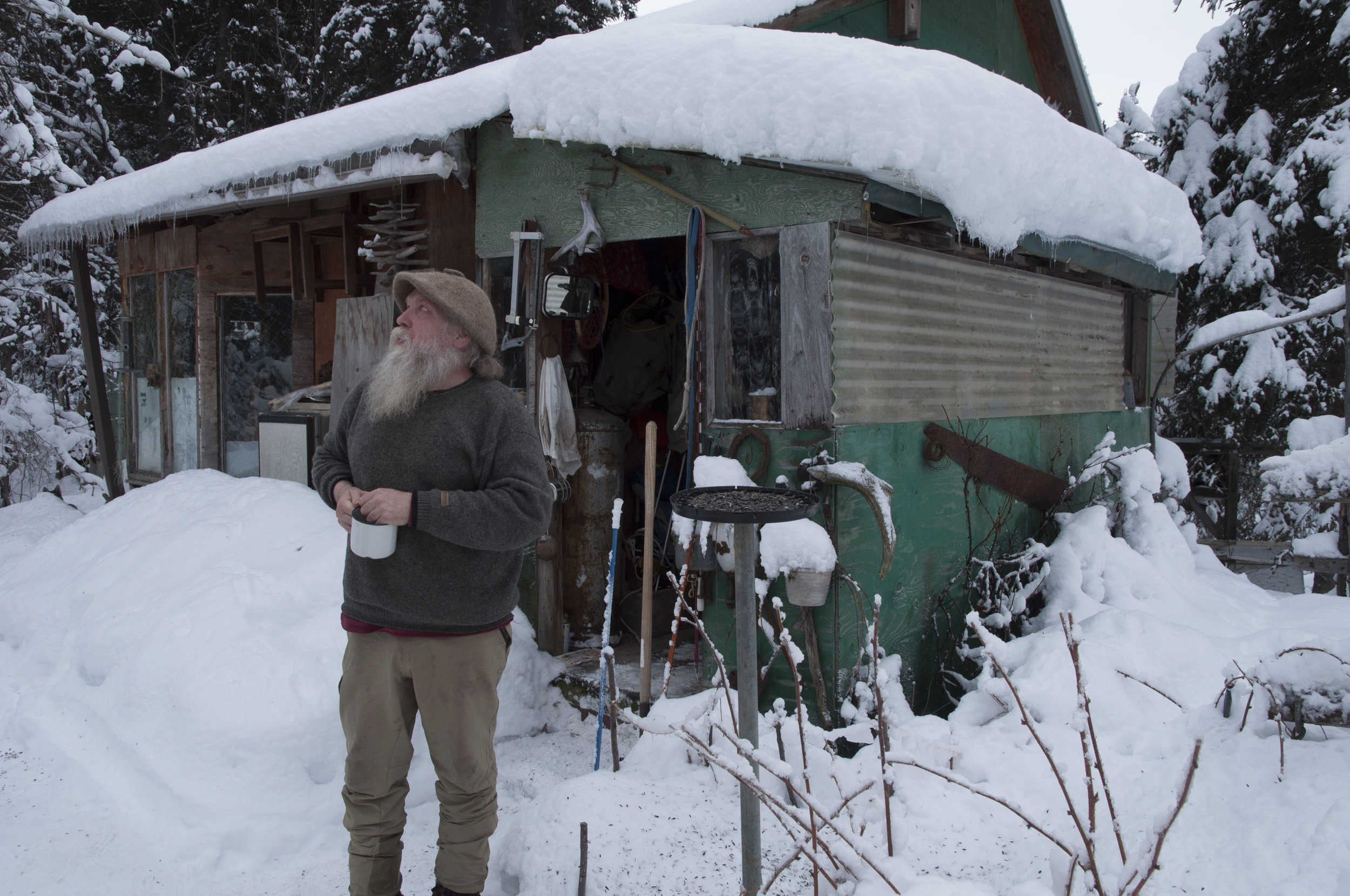 Mark Vail outside his cabin