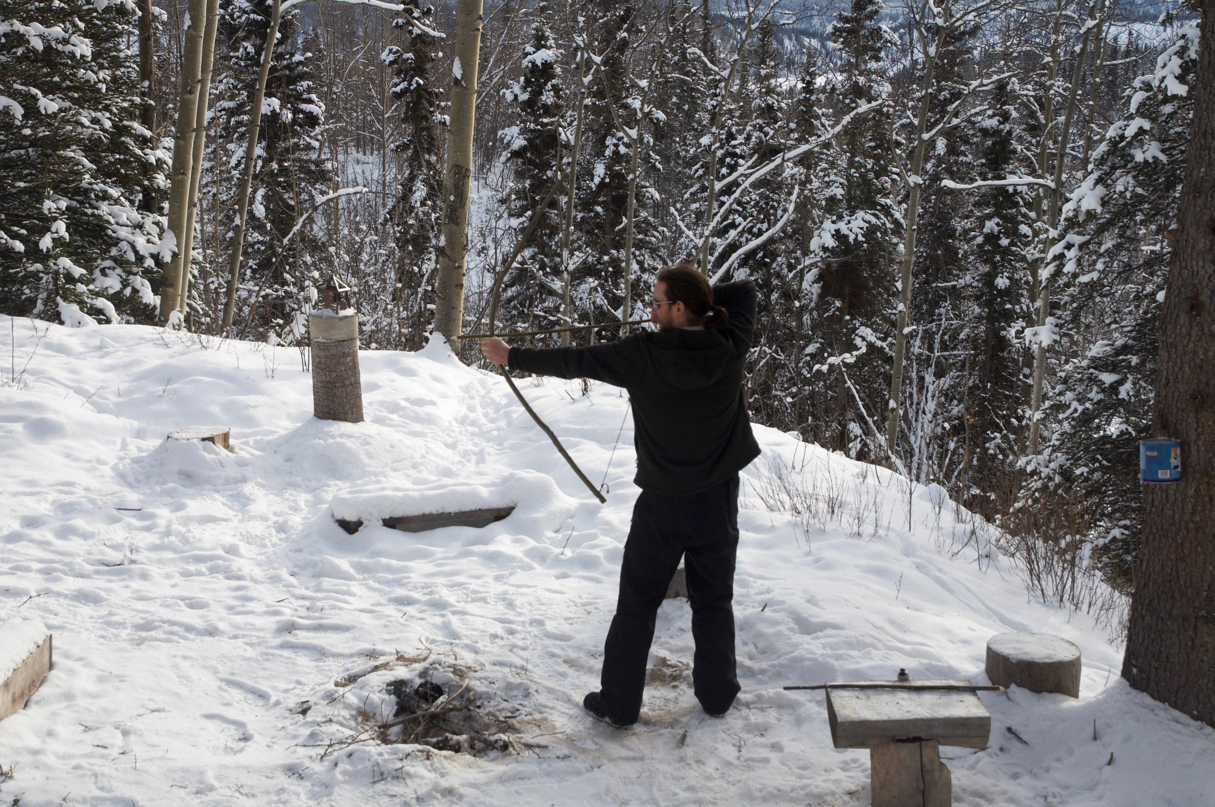 Martin Morrison shooting his homemade bow and arrow.