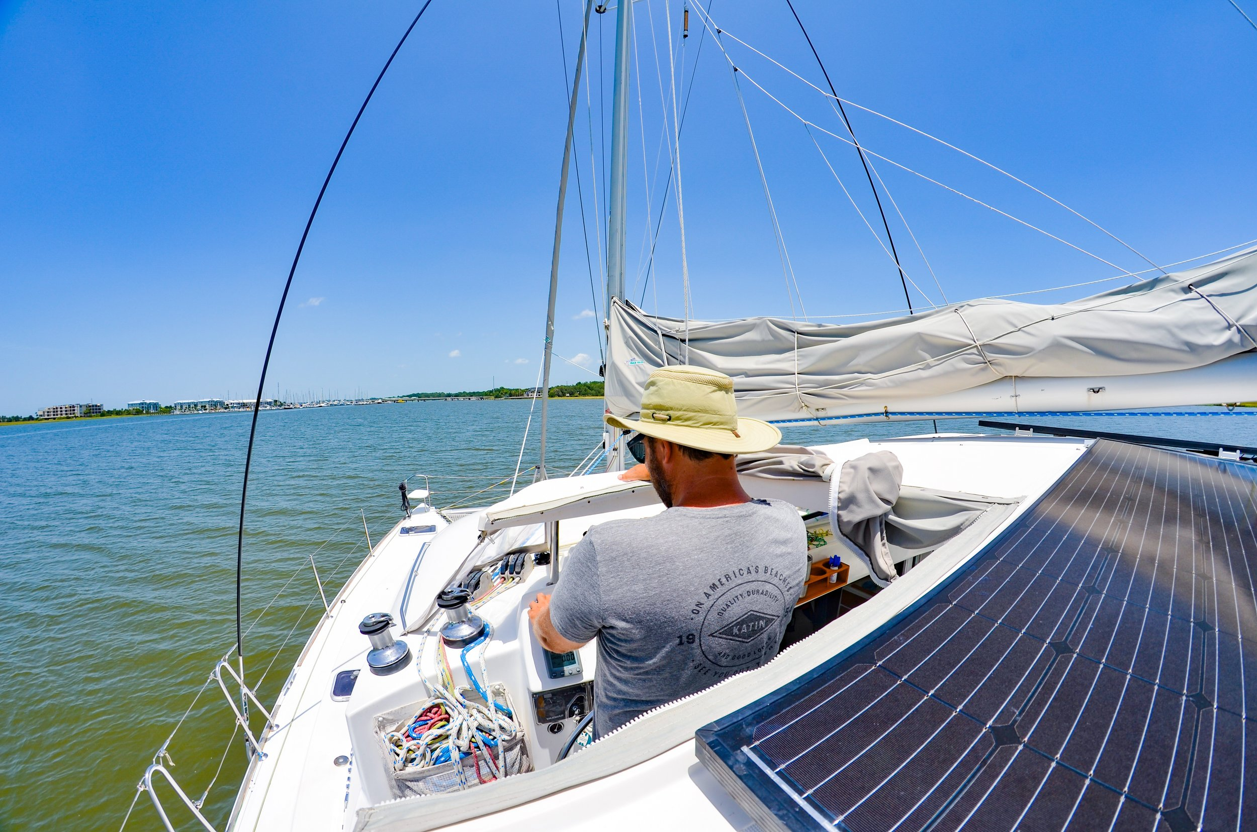 Ross-at-the-Sailboat-Helm.JPEG