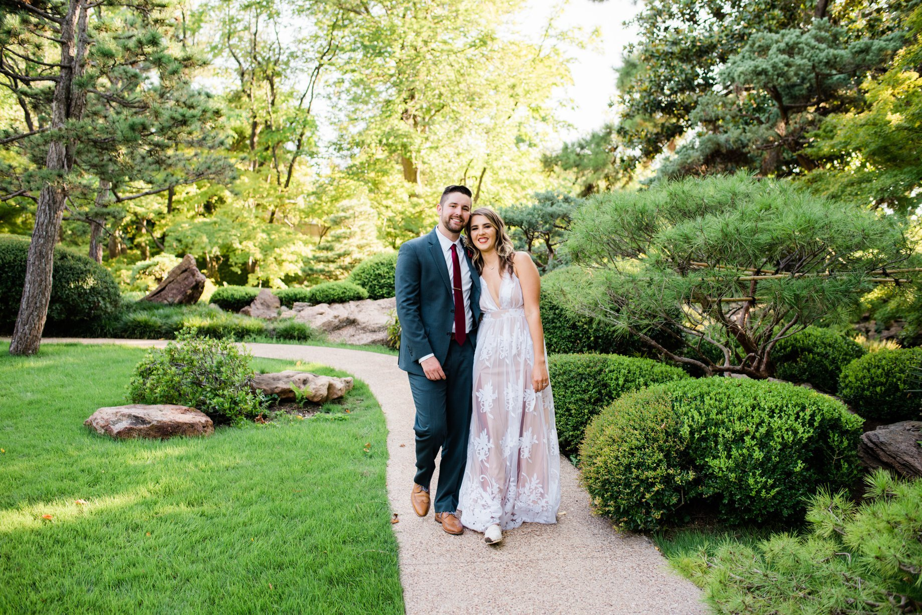 """Ashley LaSerra - """"I don't know where to start besides that Spencer is literally the best! I emailed him last second (about a week and a half before) about capturing our small ceremony at the botanical gardens in Fort Worth. I got lucky that he was available and I am so glad that he was. He is very responsive and cares about what you're looking for in your pictures. He makes you feel relaxed and is a natural behind the camera. It's reassuring to know I will forever have a photographer here in Texas! His prices are absolutely do-able and he had my pictures back quick! I'm pretty picky about pictures and he exceeded all expectations. I can't thank him enough!!!"""""""