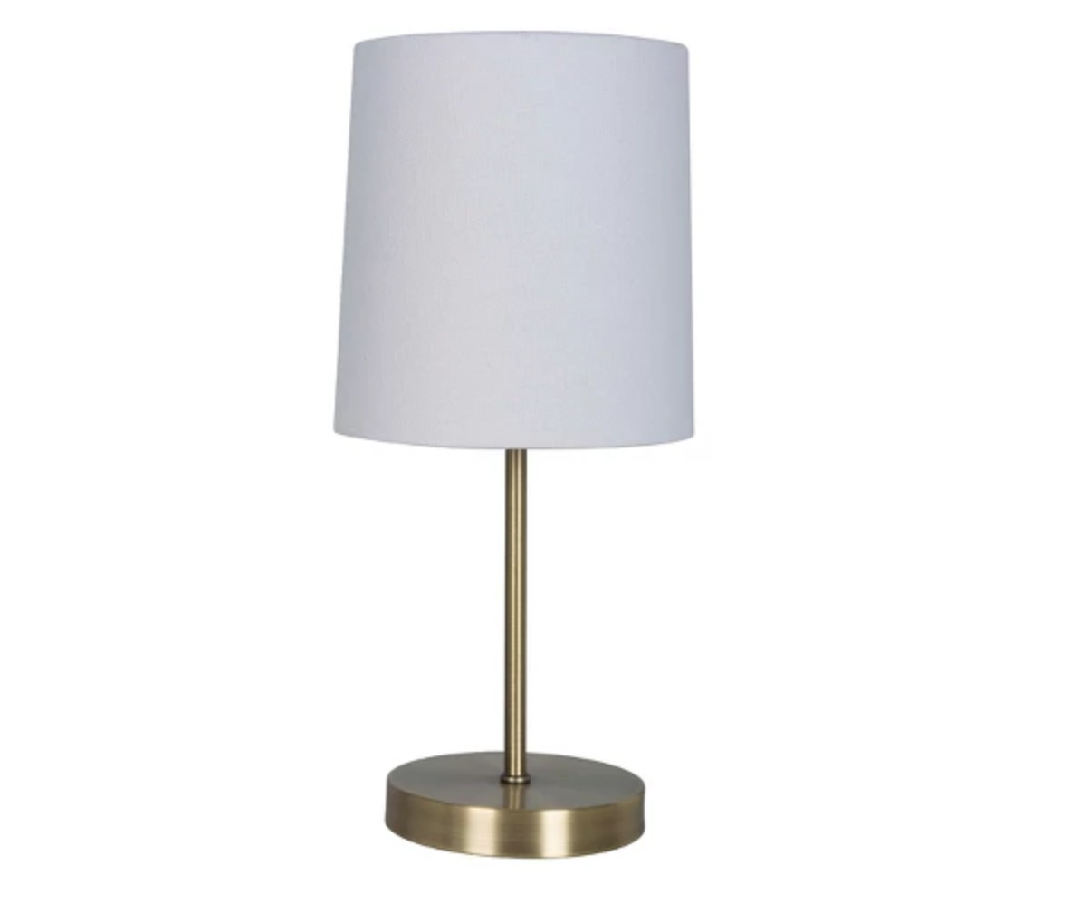 Simple and Elegant - Love the simplicity and the pop of brass in this lamp. Priced at $9.99