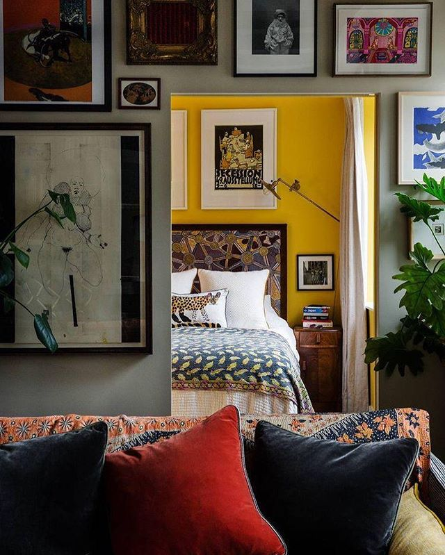 "A riot of colour and pattern. The vibrant ""Babouche"" yellow boldly used as the starting point for the colour scheme. A teeny flat in West London in the Grade-II listed Helios building where everything doubles up as storage due to its size.  A gallery wall of dreams. Custom made pieces blend with antiques. It's creative joy. . Design: Sophie Ashby and Charlie Casely-Hayford @caselyhayfordlondon  Source: @houseandgardenuk  Paint: @farrowandball"
