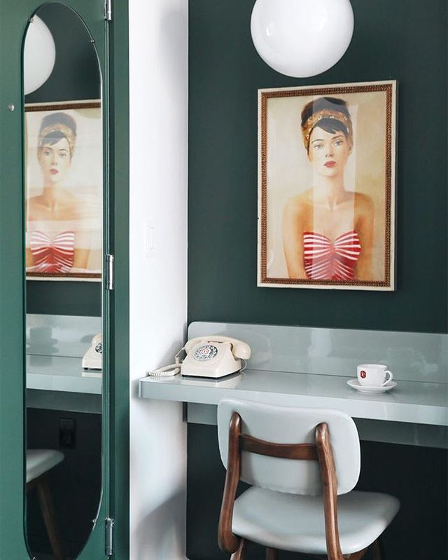 We adore the bohemian Art Deco influences, the quirky vignette with a nod to the glory of cinema. This Los Angeles hotel reimagines the boarding house that existed here in the 1920s. The colour, the curves, the art...and that telephone. A design experience. . Hotel: @palisociety Culver City Source: @citysage @pinterest
