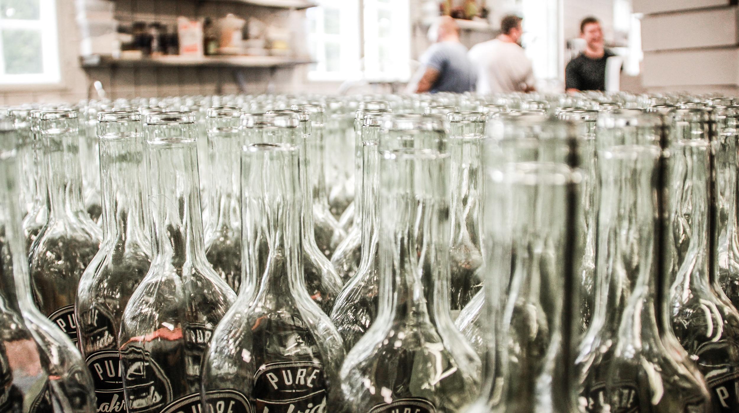 Bottles of Pure Shots on conveyor belt