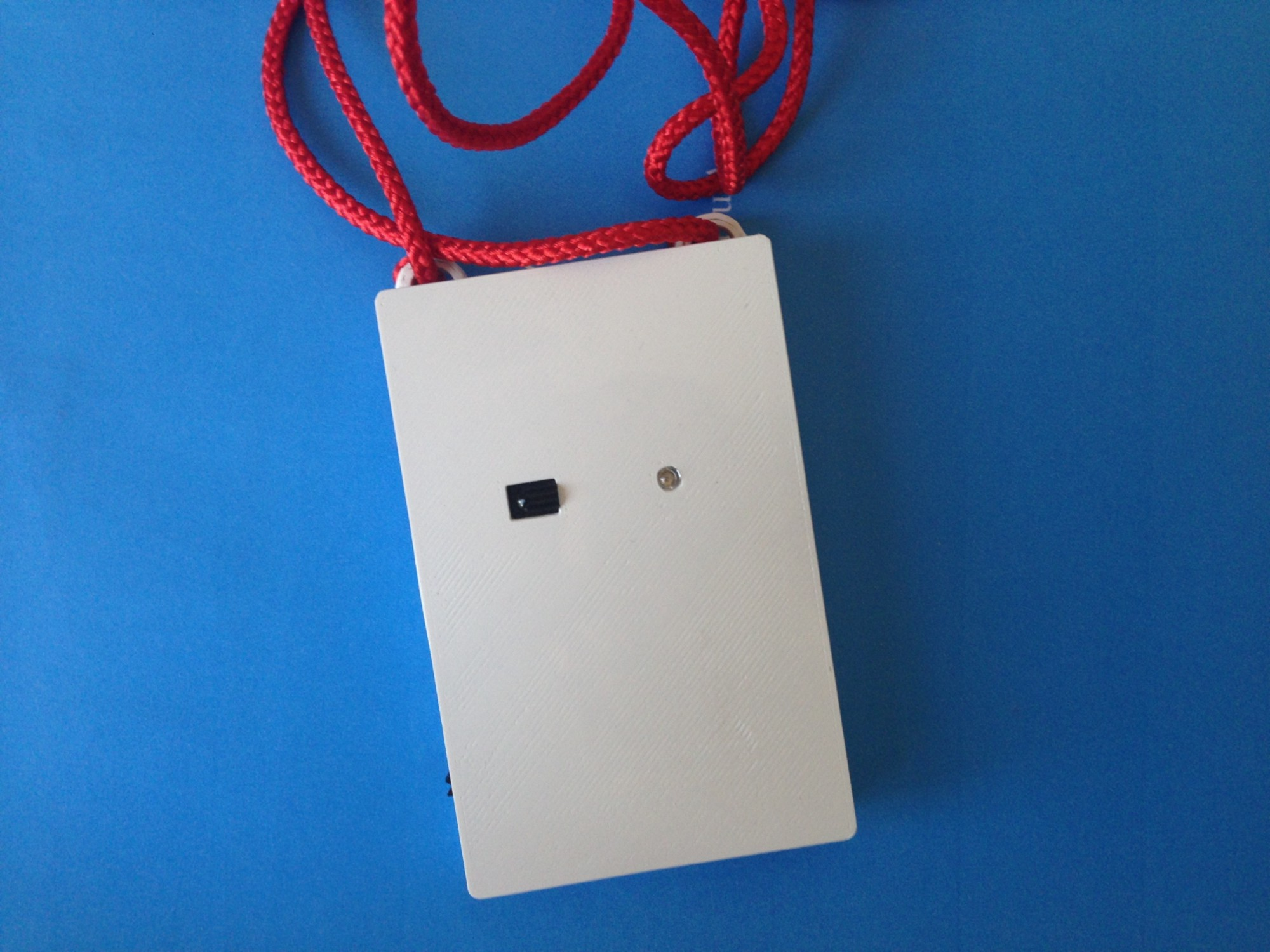 Our prototype wearable speech and proximity sensor.