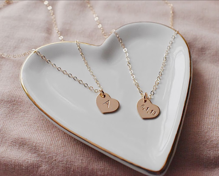 Lovely Necklace - A dainty little heart stamped with an initial, a date, or a sweet little something. Comes as a single heart or layered with a few!