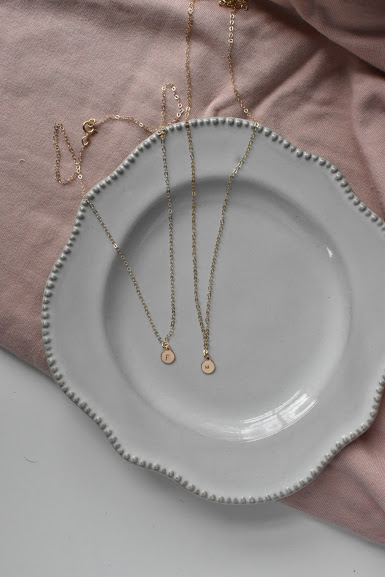 Olivia Tiny Oval - These NEWBIES are just so dainty and perfect for everyday. You can get a single oval or up to 5 on one necklace. Perfect for initials of a couple or of kiddos.