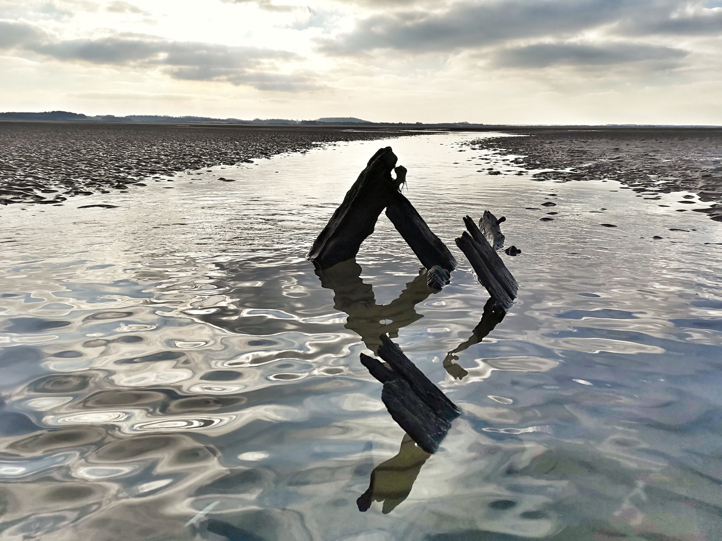 An unknown wreck exposed at low tide far out on West Sand.