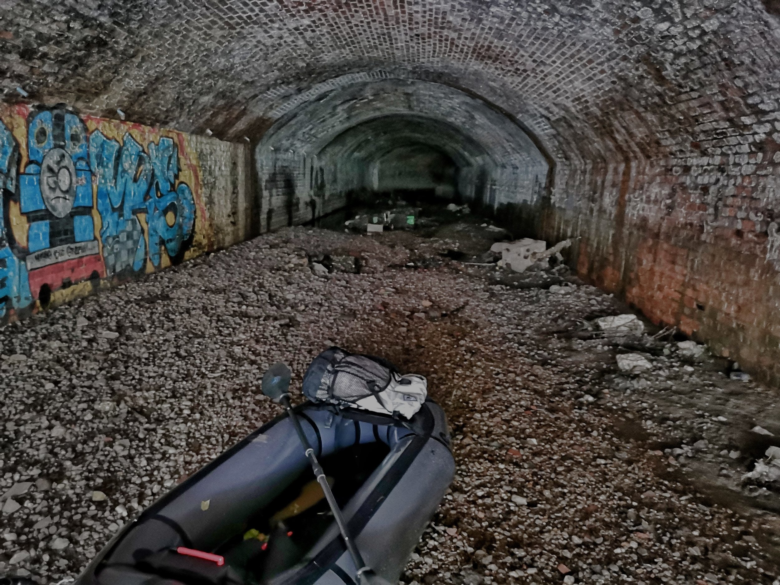 The tunnel on the right was partially dry so I opted to walk it rather than getting swept through the black hole to the left. This meant carrying my packraft as I waded through mud and discarded rubbish for approximately 300m into the black stinking darkness.