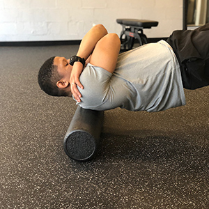 Next, slowly roll to the top of the shoulders by pressing the feet into the floor to lift the hips.