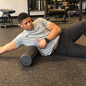 To target the lats, start in a side lying position with the roller near your middle rib.