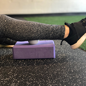 Using any elevated surface allows your to play with different angles and pressure. Start with the ball in the center of the gastrocnemius (large calf muscle) and roll around.
