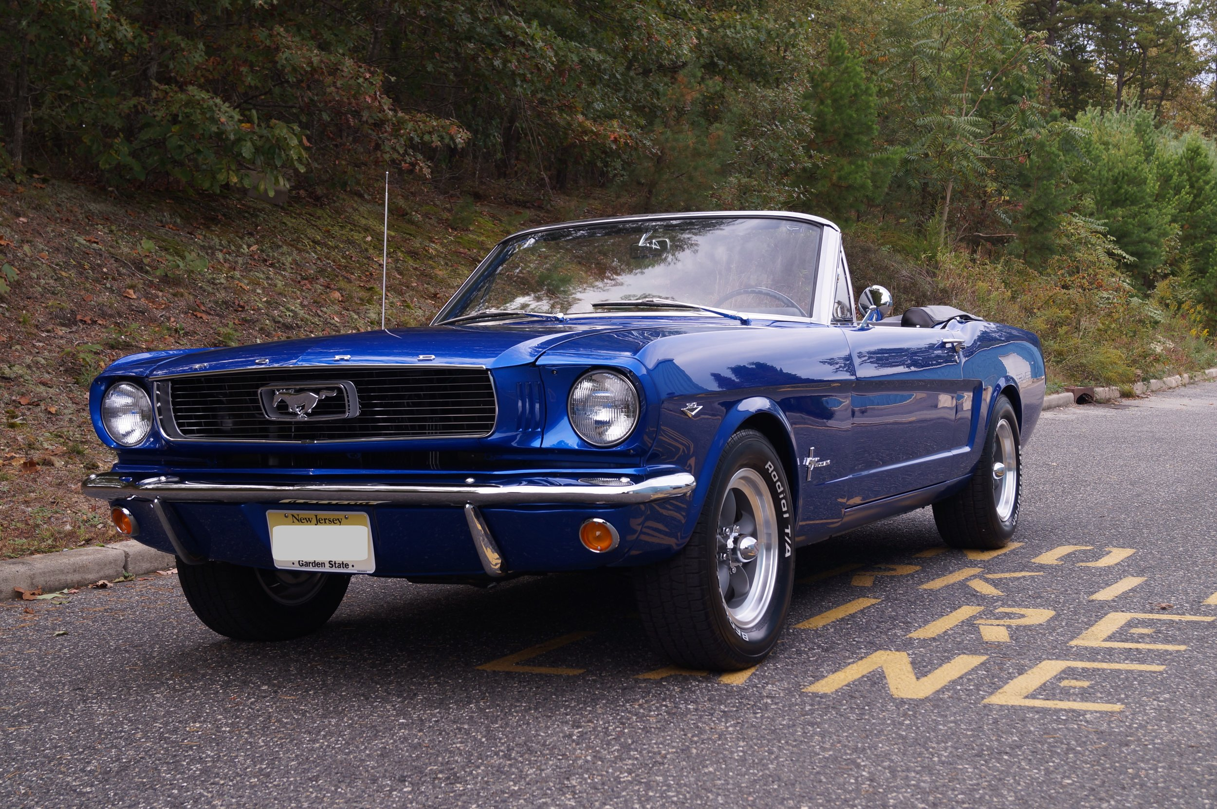 1966 Ford Mustang 347 - This Mustang spent its twilight years as an under-powered and neglected pony car, but as you can see, has been reborn as an electric blue, earth-pounding stallion. We swapped out the 200 cubic inch engine for a 347 V8 that produces 425 horsepower! Mated with a Tremec 5-speed, this sure makes for one fun driver! And drive it the owner did. Just weeks after its completion, this car took a road trip from New Jersey to Colorado and back! If the paint looks especially like eye candy to you, that's because it is. This is a three-stage paint, or otherwise known as a tri-coat. This means that there is one layer of solid color, followed by a second layer of a transparent color, and a third layer of clear coat.