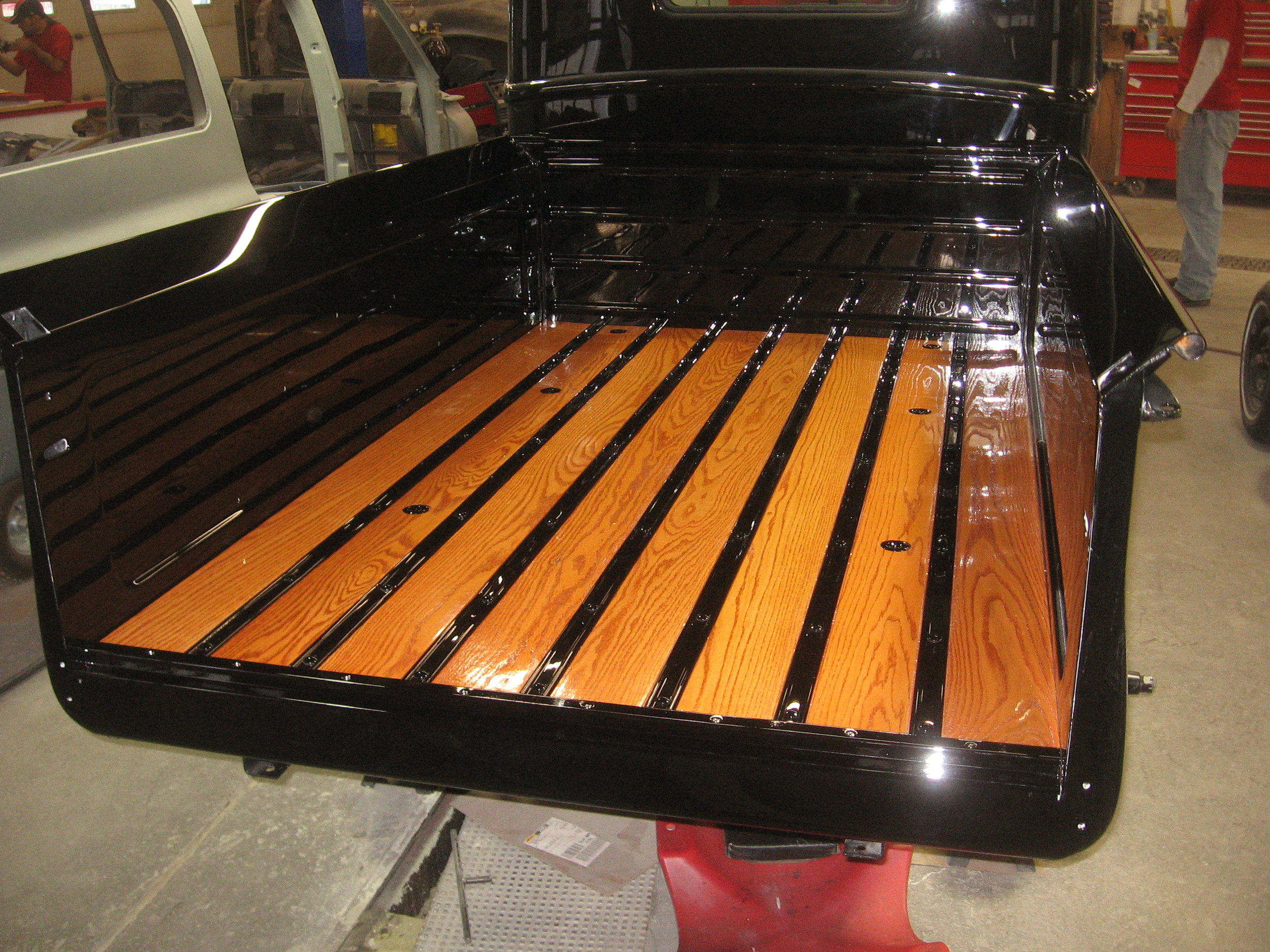 1947 Ford Pick-Up -- Installation of bed wood after staining and varnishing.