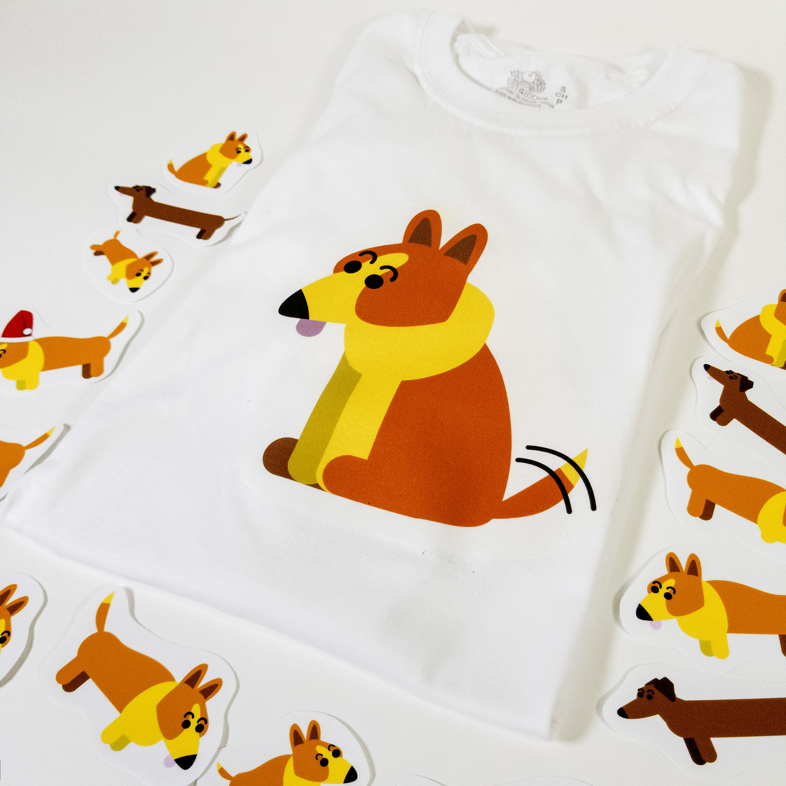 memorabilia - A T-shirt and stickers, the first in a line of The Conscious Corgi-based products.