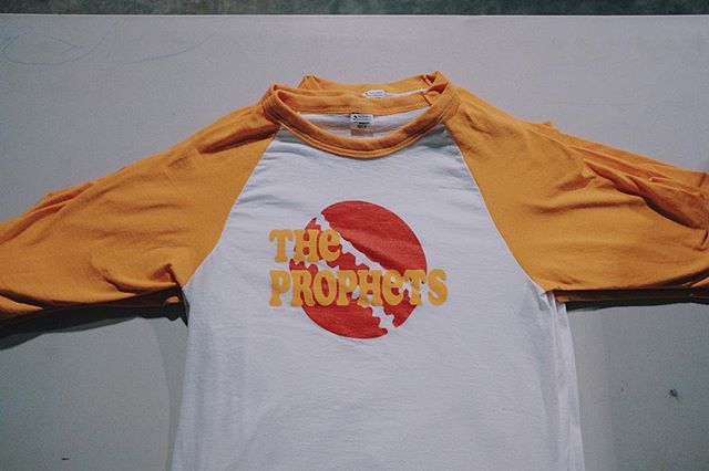 Threw these bad boys down for the @vudivinity softball team, The Prophets. Designed in house with some 70s love by @chrischaput . Plastisol gold and red on @augustaactive yellow gold baseball tees. WE LOVE SPRING. . . . #screenprintingsucks #screenprint #screenprinting #screenprinter #printisnotdead #localbusiness #merch #nashville