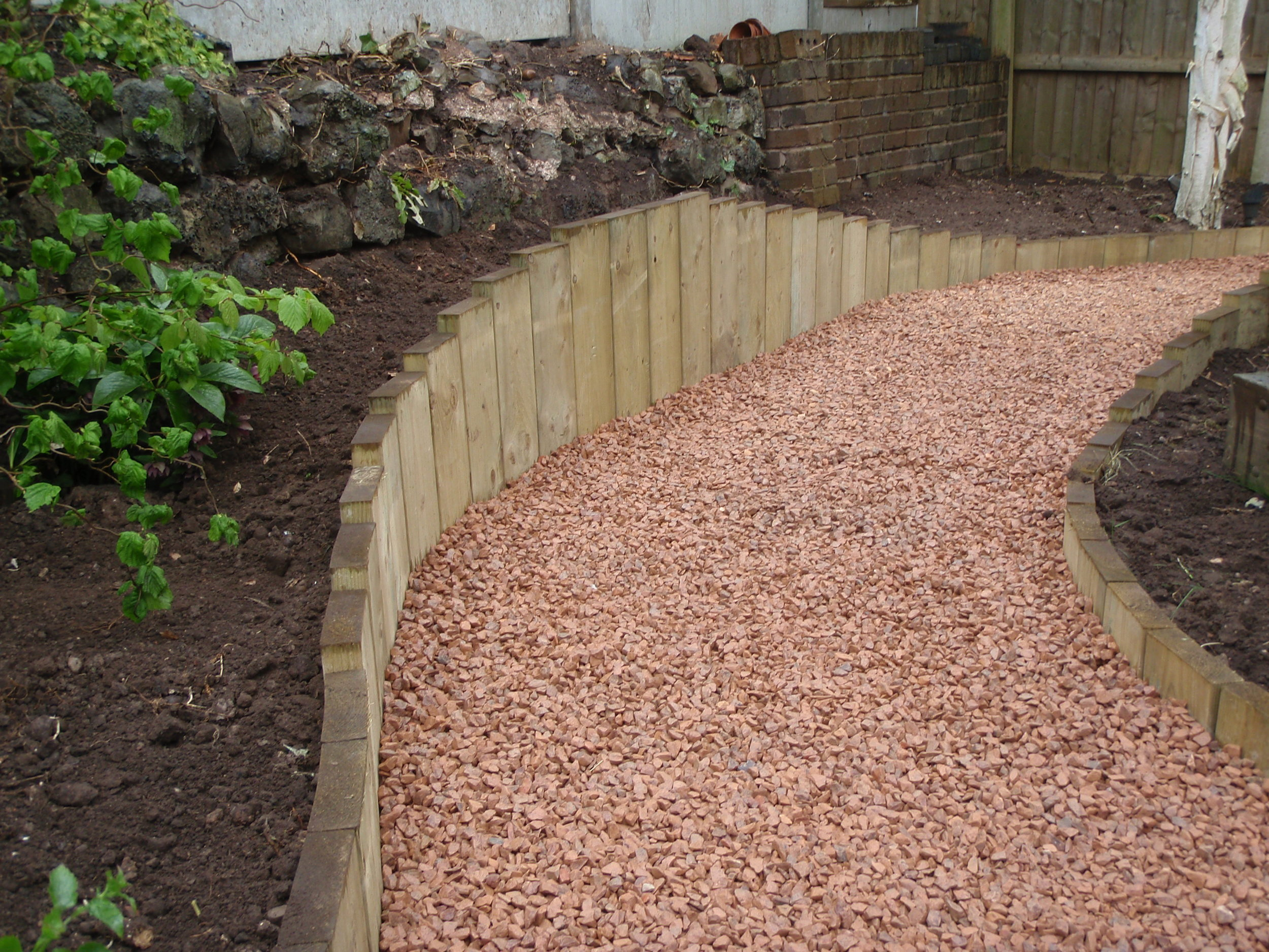 Garden path with Forest of Dean stone chippings edged with upright treated softwood - Parkfield Road, Stourbridge