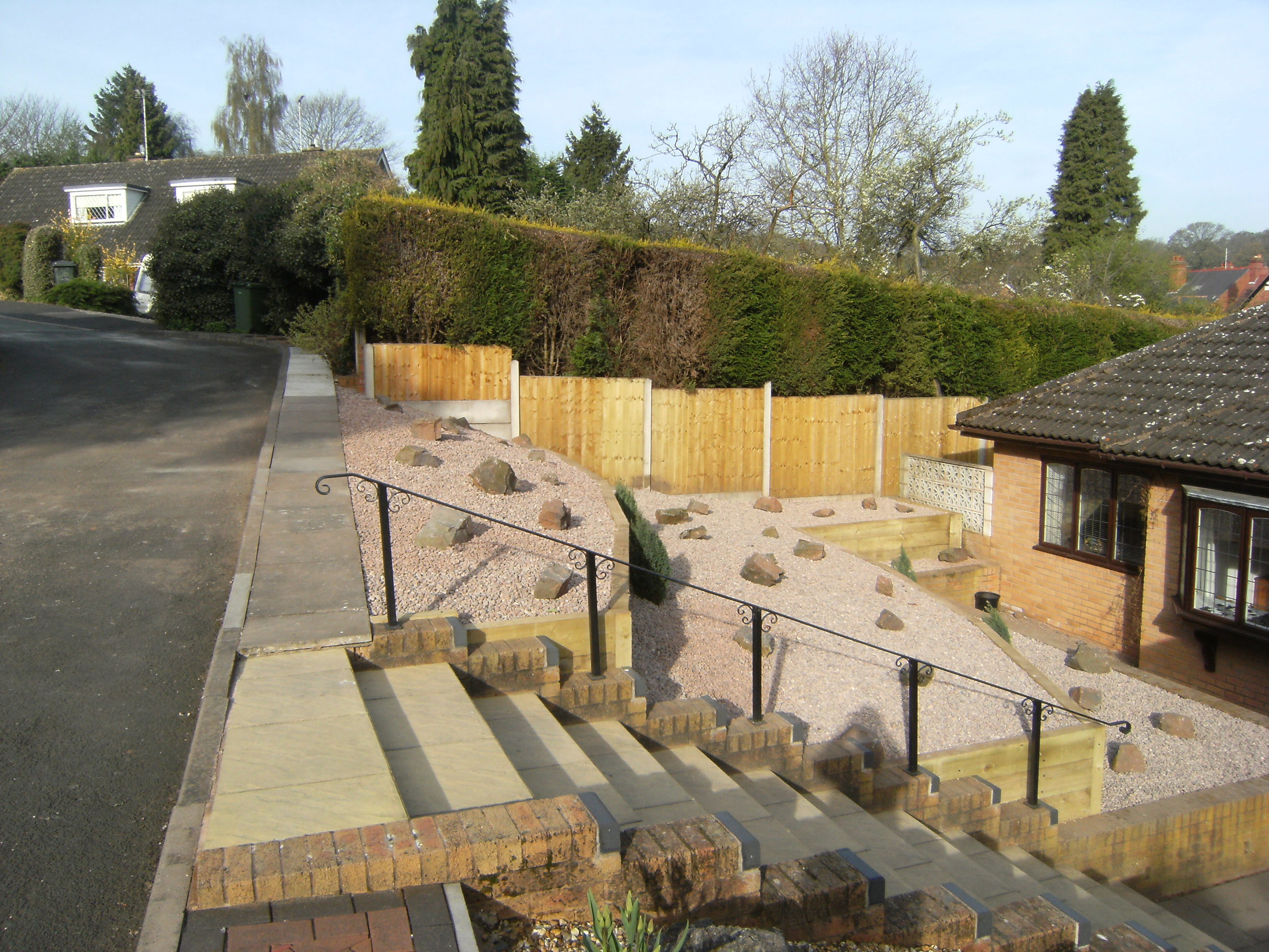 Steep sloped garden bank replaced with treated wood sleeper retaining