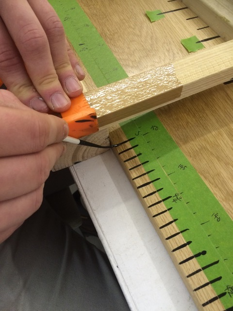 Hand painting the ruler for the kitchen