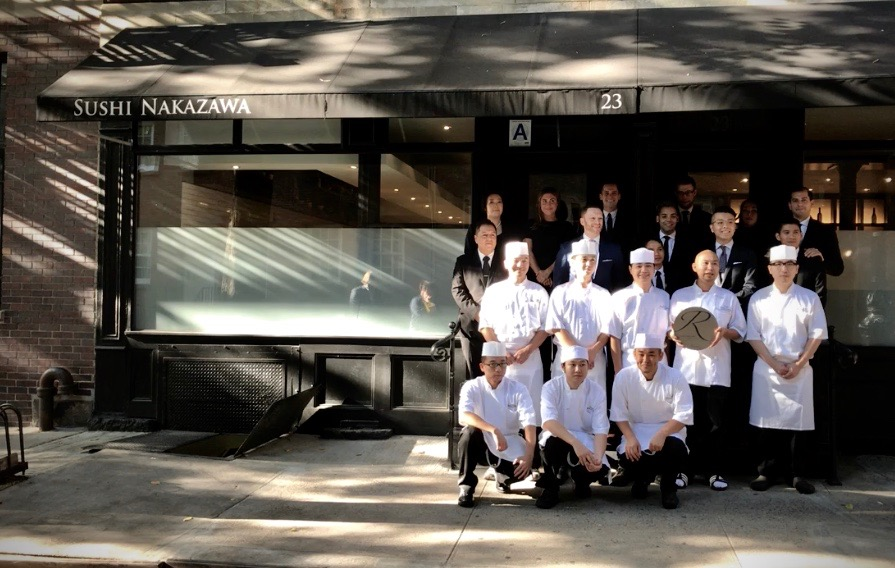 The Sushi Nakazawa team poses with their Renzell plaque.