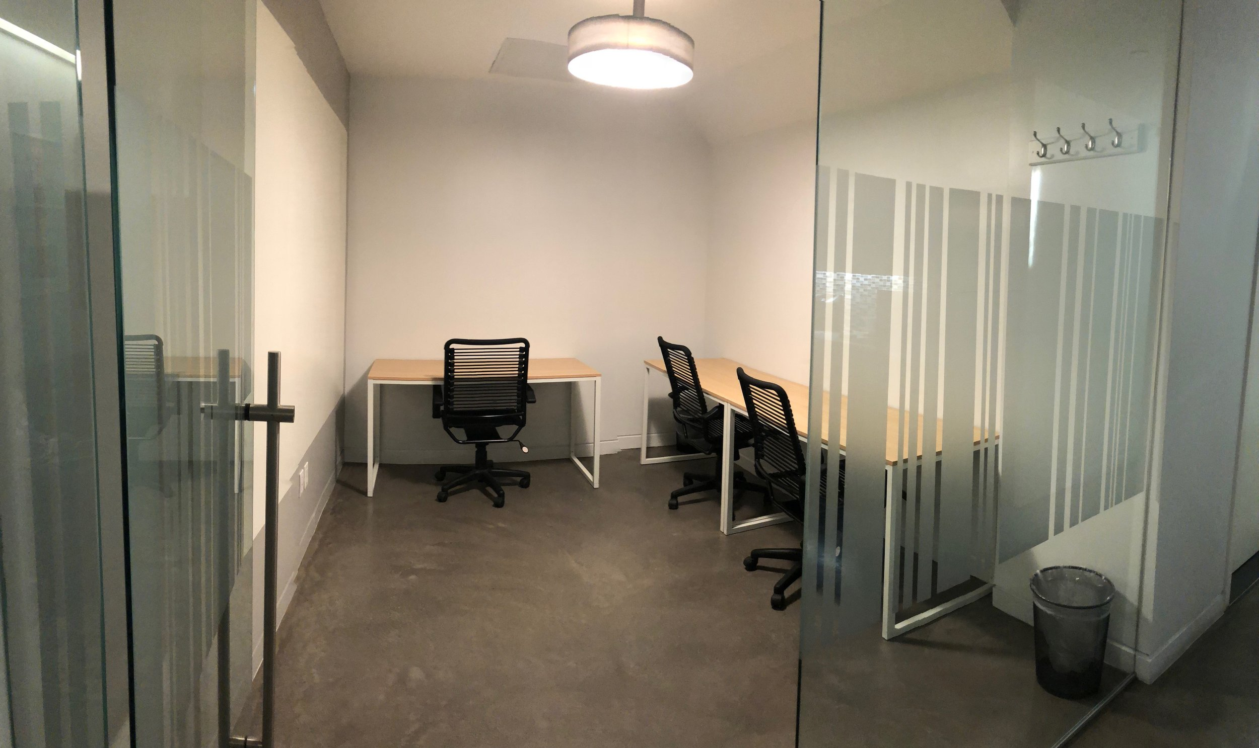 Whiteboard wall , seating for 3-4 desks