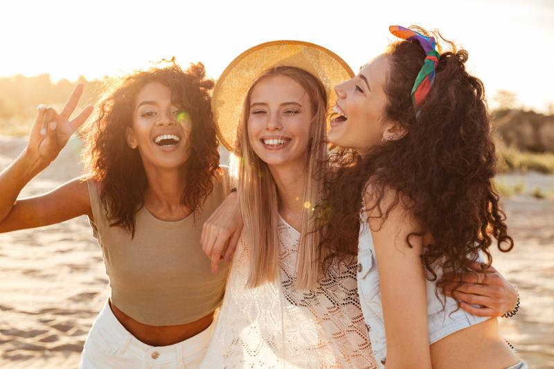 Image of three joyous multiethnic girls 20s in stylish clothing laughing and___.jpg