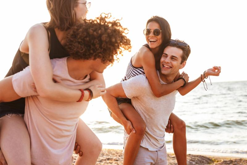 Picture of happy group of friends loving couples walking outdoors on the beach.jpg