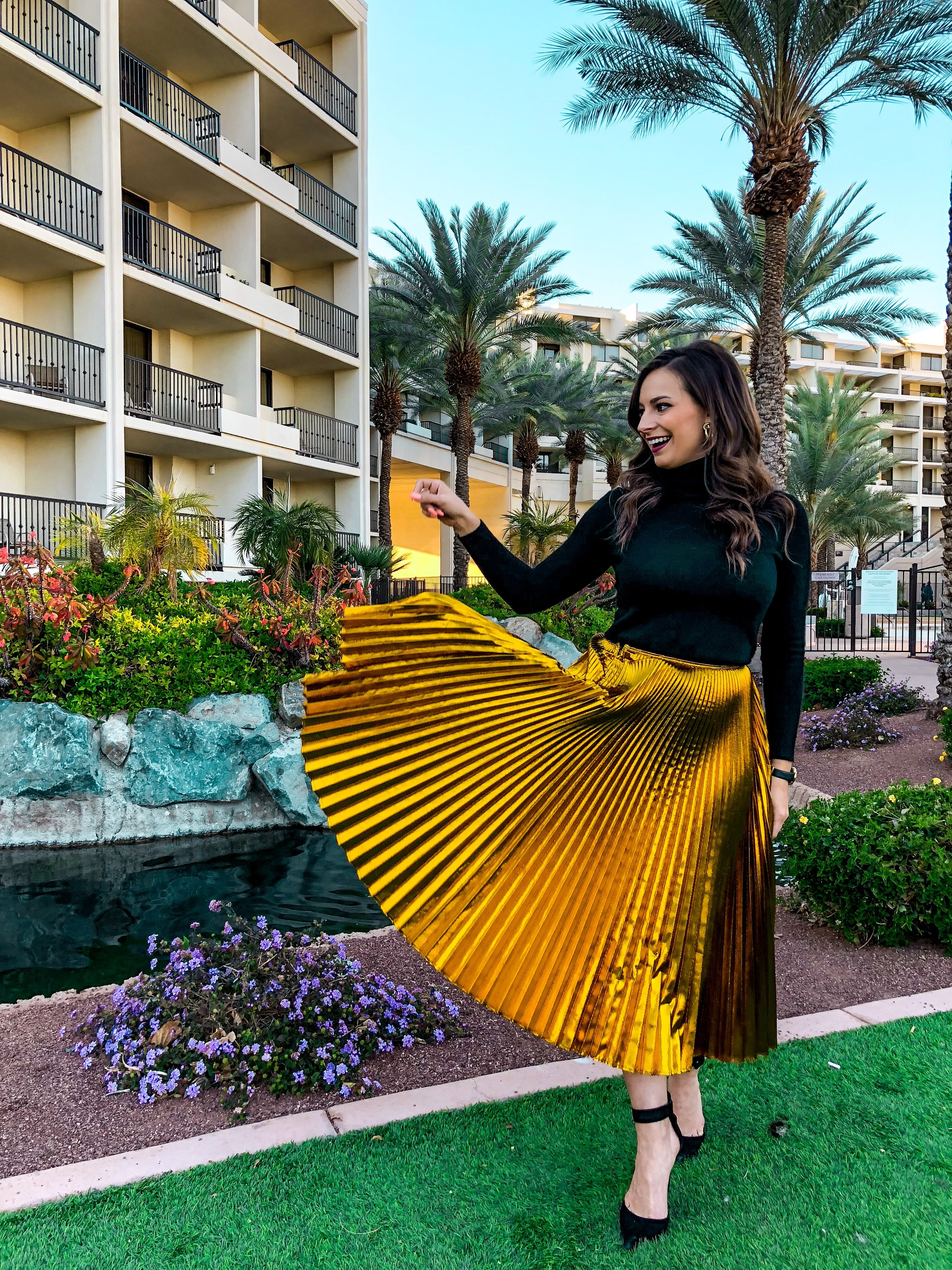 Cedric Charlier:Golden Sky Pleated Skirt - While the backdrop of this photo might not scream holiday, this skirt sure does.