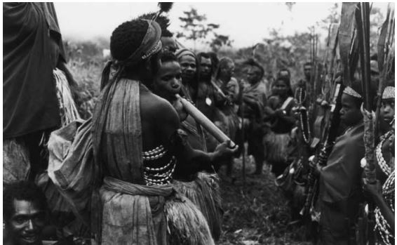"""An older initiate shows how to suck the flute."" - From ' The Sambia: Ritual, Sexuality, and Change in Papua New Guinea' (2006)  by Gilbert Herdt."