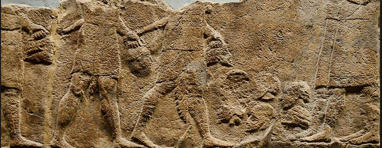 Wall decoration depicting Assyrian warriors carrying severed heads during the siege at Lachish (8th-7th century BC). From the British Museum; photo by Ferrell Jenkins.