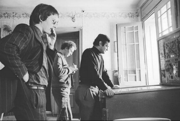Austrian author Peter Handke and artists Peter Pongratz and Kurt Kocherscheidt (at the pin-ball machine) at a guesthouse in Neumarkt/Raab, 1968. Photo by Otto Breicha