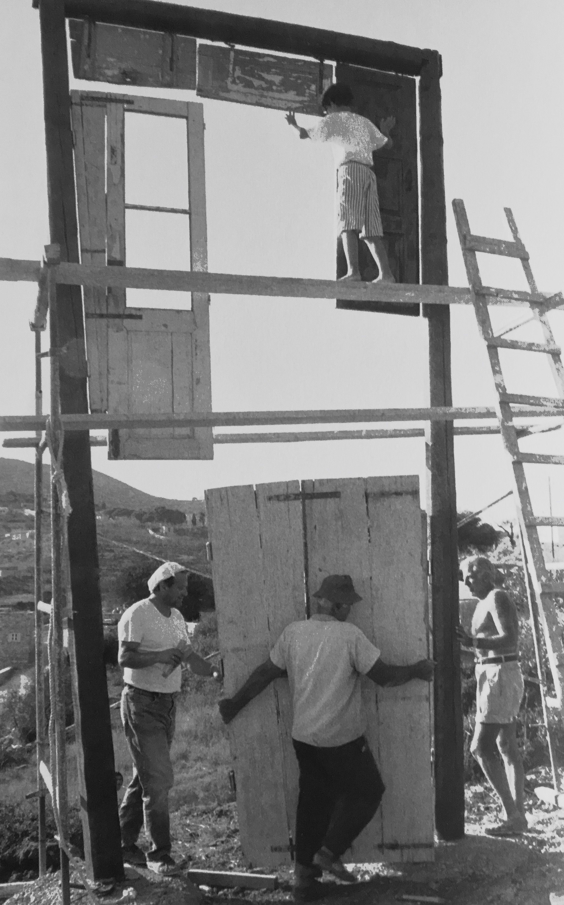 Kocherscheidt with Mariano Roussos, Michel Würthle and August building  Tor der Winde , Syros, 1992. Photo: Elfie Semotan