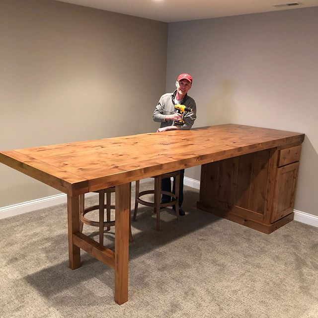 Rustic alder pub table with two-sided cabinet. This was definitely the largest scale project we've done - used four person moving crew to fit it down the basement stairs! Just one inch clearance, piece of cake.
