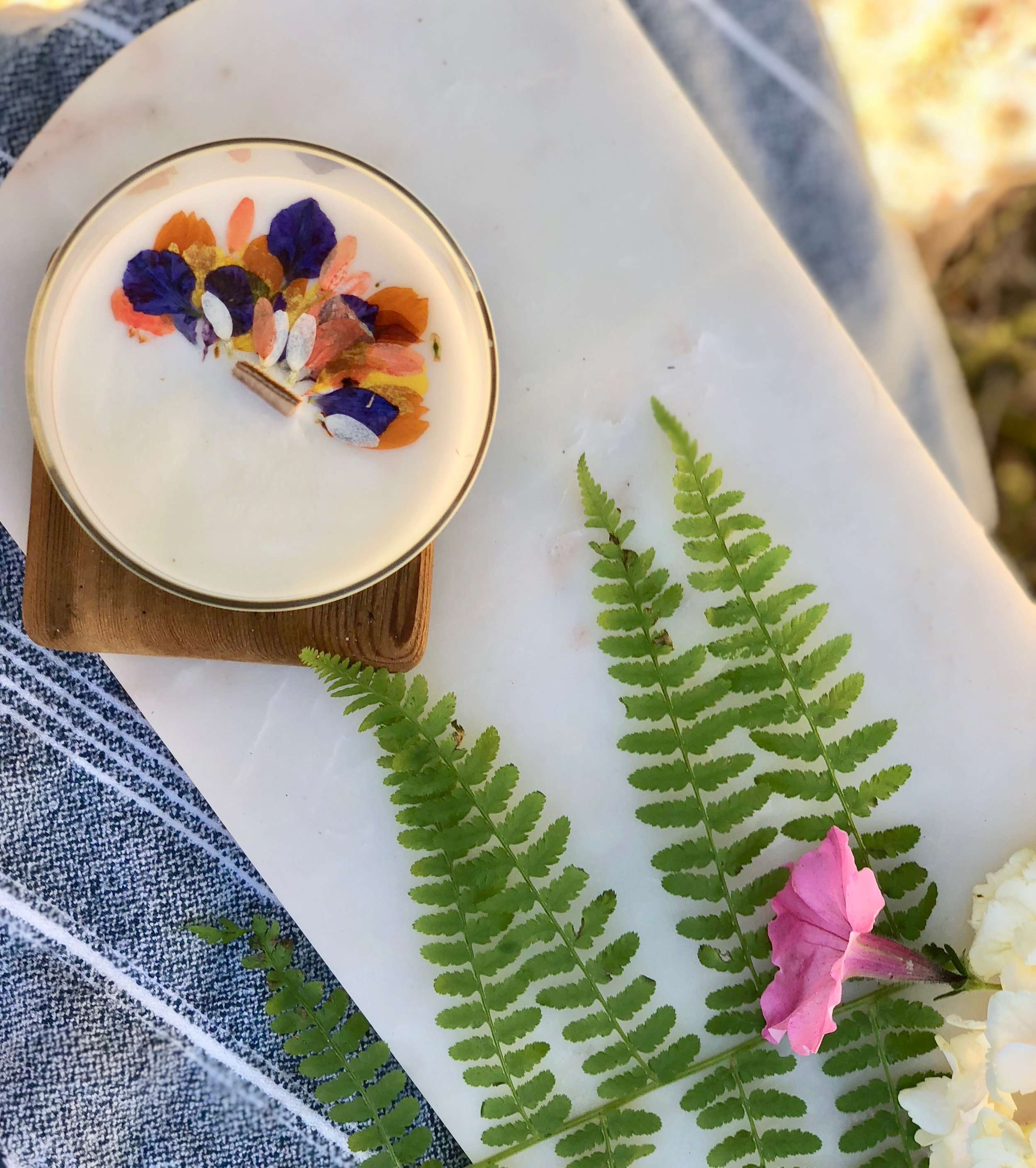 signature candles…Featuring pressed flower designs - artisan crafted with all natural ingredients including sumptuous essential oils and natural fragrance enhancers, soy wax from a renewable source, cotton and wood wicks, and recyclable containers