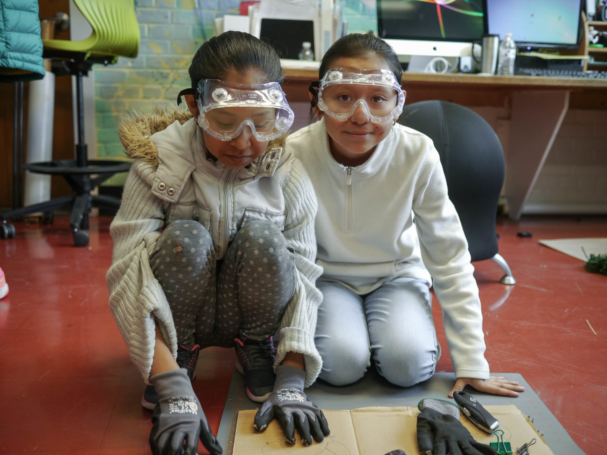 Children work on their projects at the INDE lab.