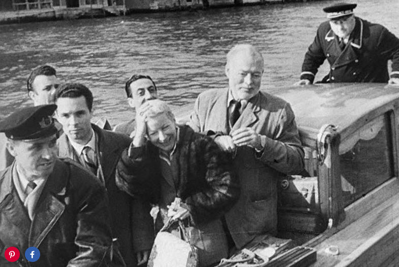 """Ernest Hemingway and his fourth wife, Mary, arrive at the Gritti Palace in the 1950s, following an African safari. The manager of the hotel was stunned by the writer's prodigious consumption of alcohol, observing that """"three bottles of Valpolicella first thing in the day were nothing to him."""" Hemingway once staged a midnight baseball game in the hotel's lobby—and instead of being reprimanded, the great American scribe had 10 percent taken off his bill, since nobody had ever played the sport on the premises before."""