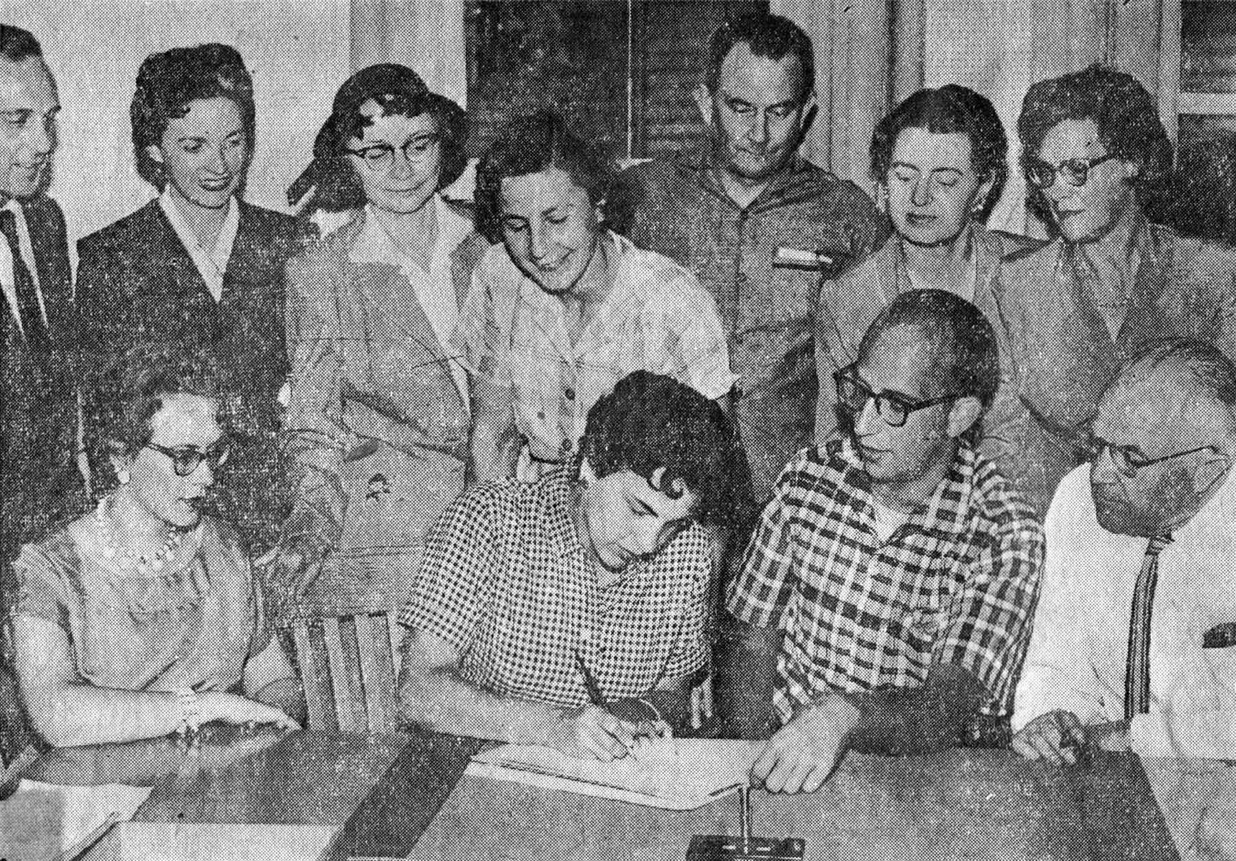 THREE ISLANDERS ARE SHOWN as organization is completed in the University of Washington campus, Seattle, of Washington Arts and Crafts. Standing, third from the left, is Mrs. George Dennis, Sunrise Drive, president of Bainbridge Arts and Crafts, who was chosen to be a member of the steering committee of the new statewide group. Seated at left, is Mrs. Richard Morley and standing, extreme right, is her mother, Mrs. Lawrence Eager; both are summer residents at Seabold. (10-3-1957)