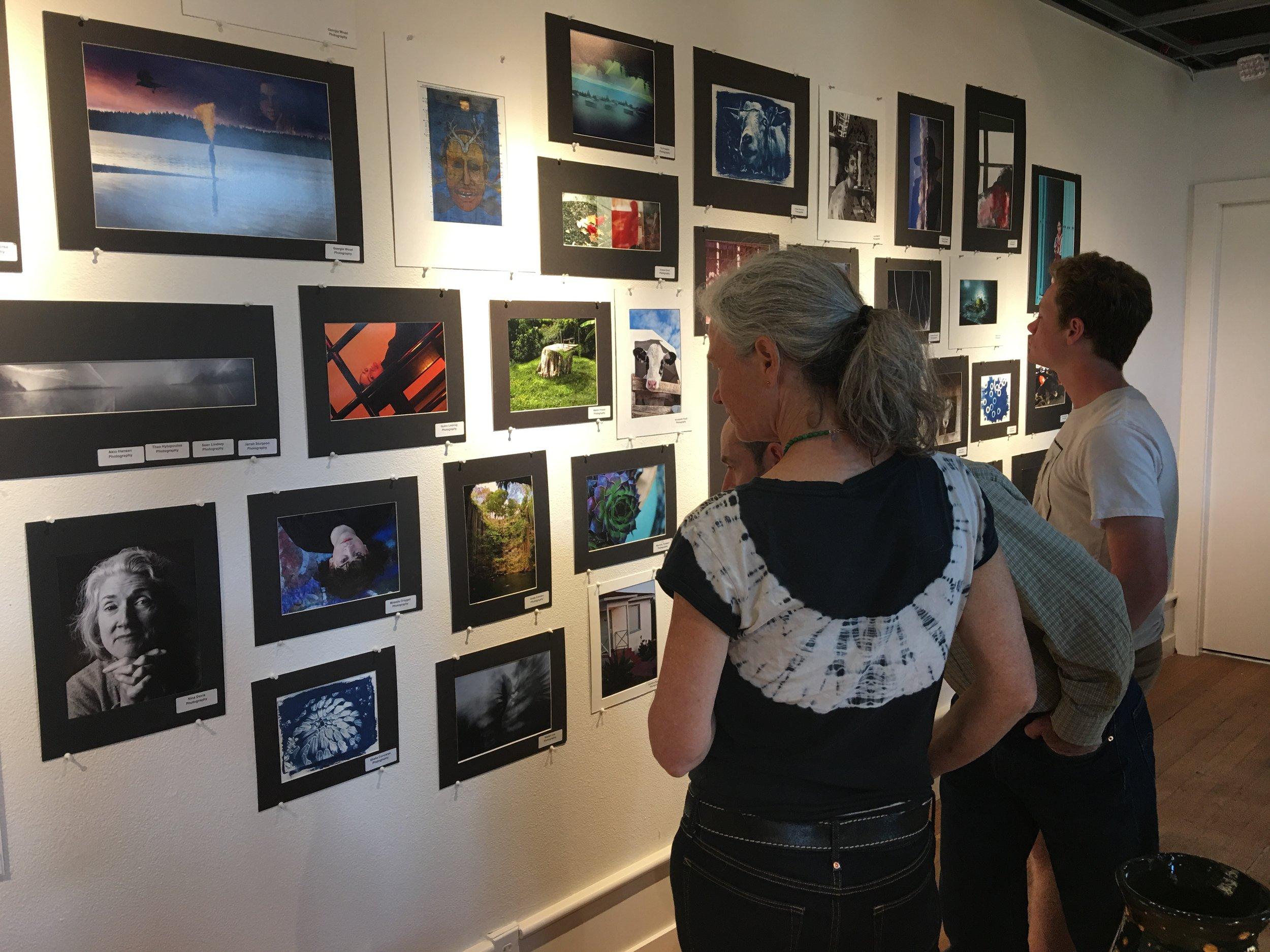 Gallery visitors enjoy the High School Student Art Show.