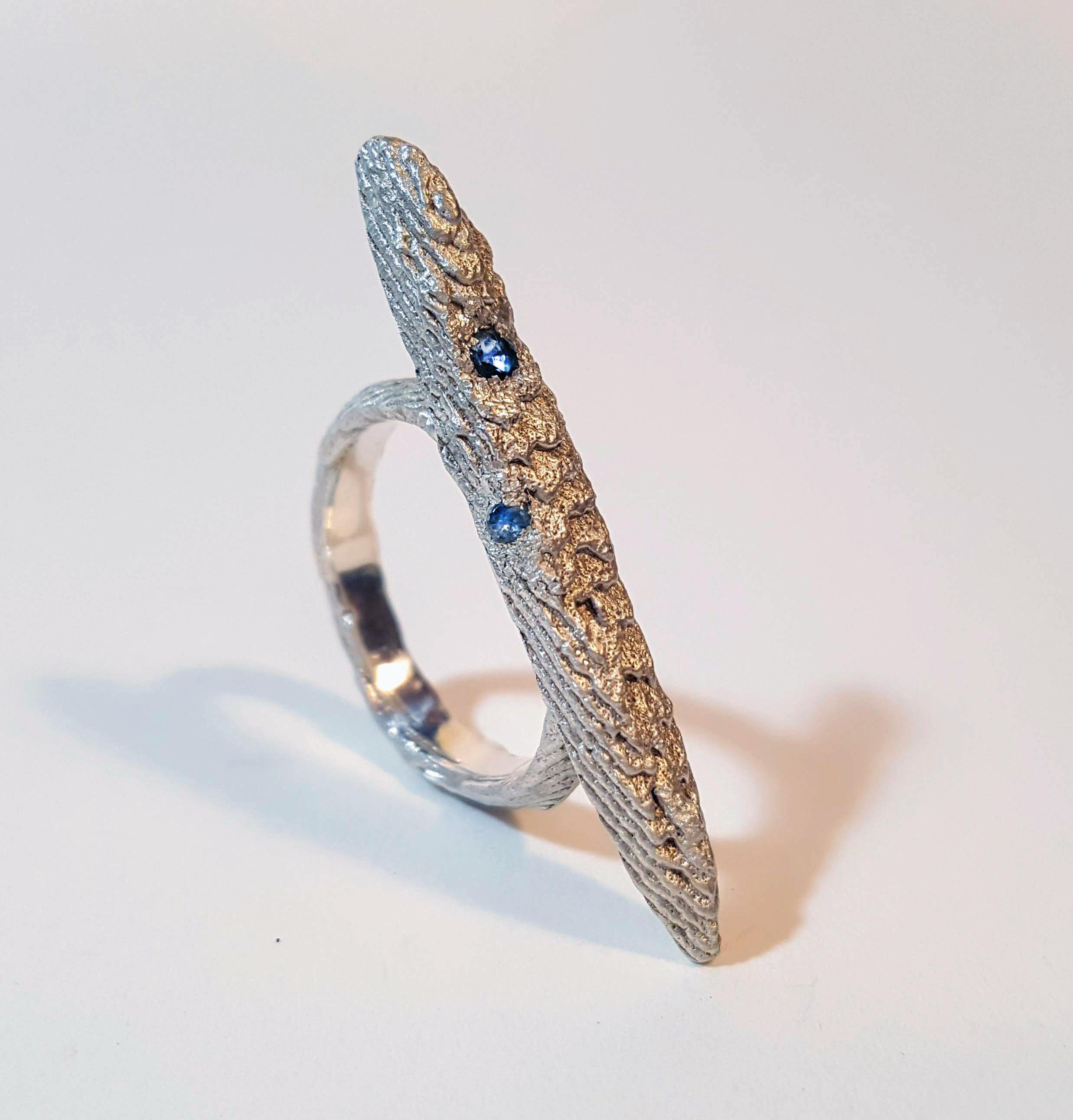 Sarah Jones,  Ocean Blue, c ast cuttlefish in sterling silver, sapphire.