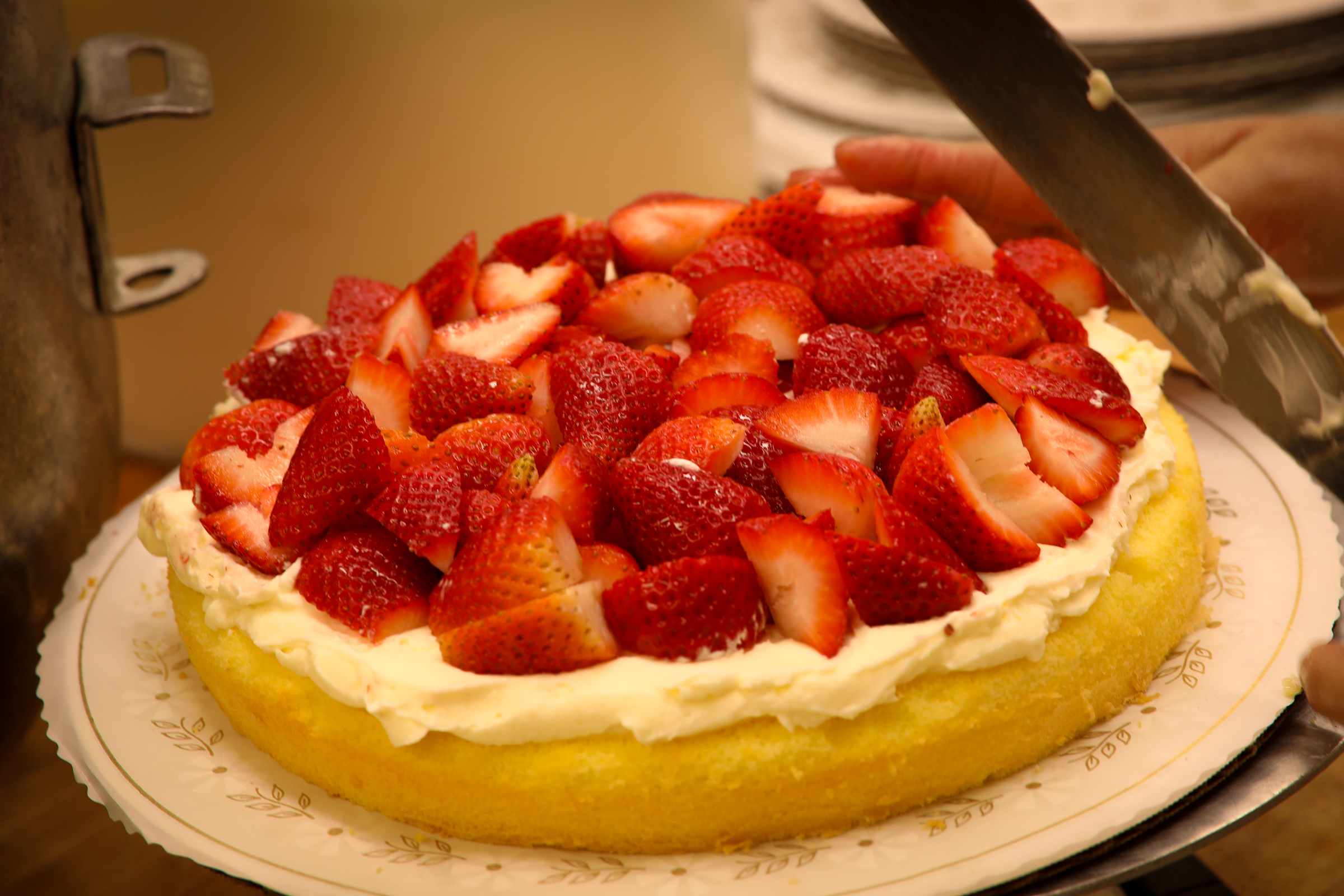 Fresh strawberries packed onto our cakes.